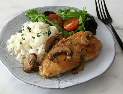 Chicken Marsala with mushrooms on a plate.