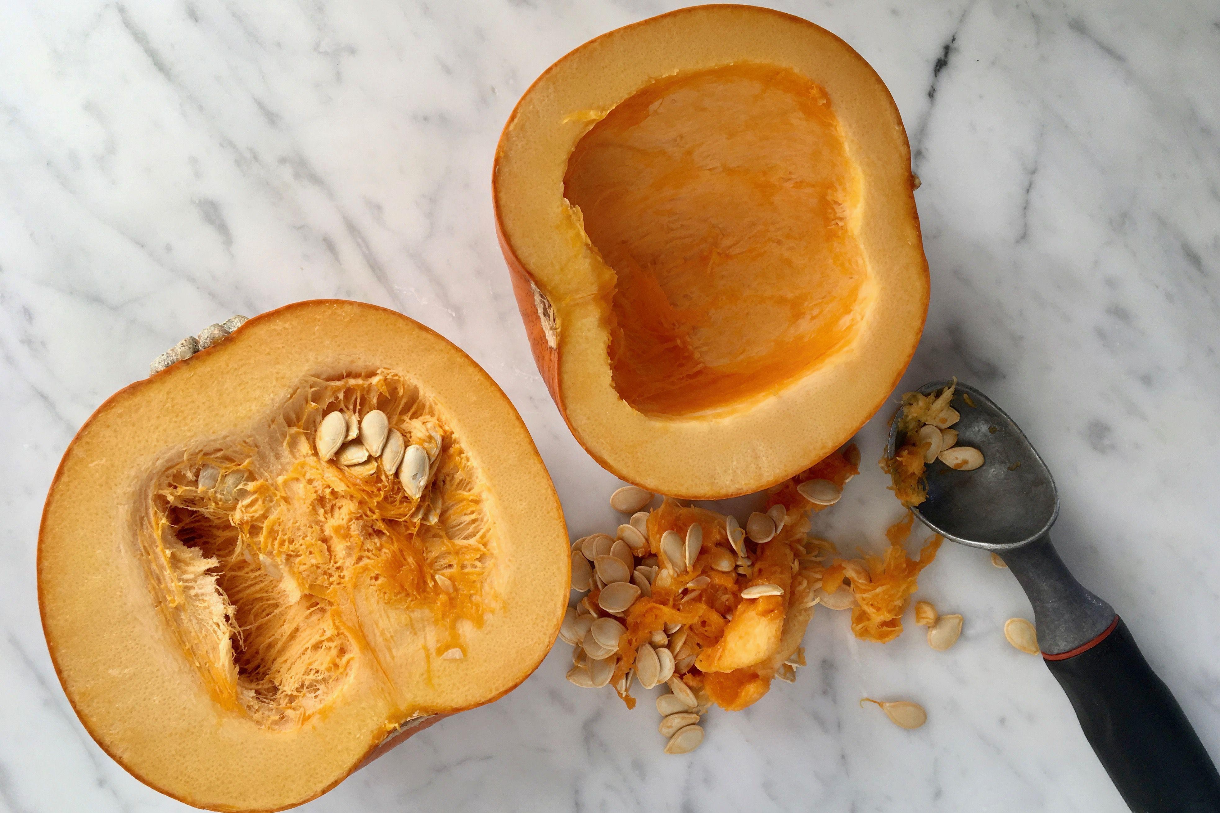 Scooping a pumpkin