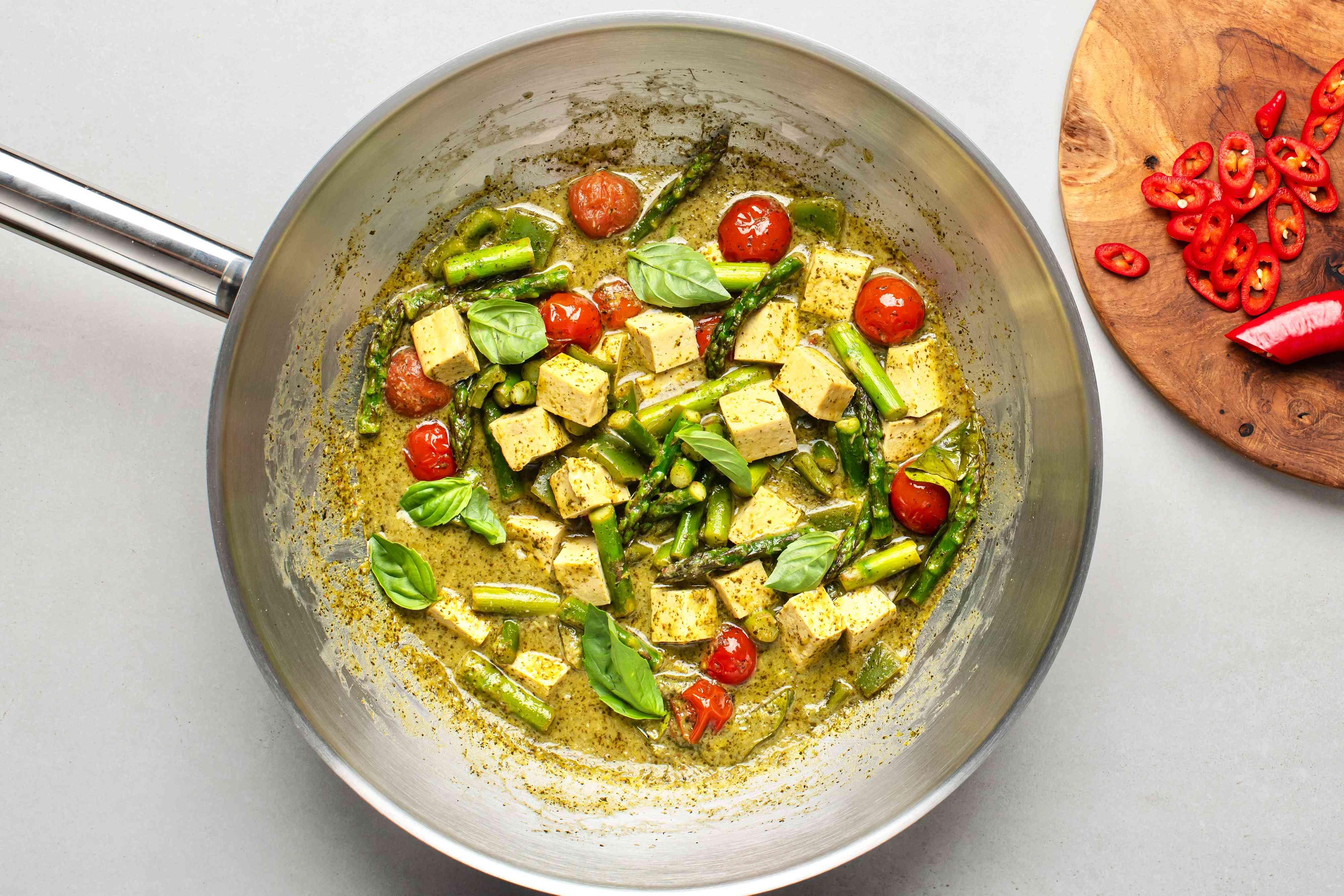 Vegetarian Thai Green Coconut Curry in a wok