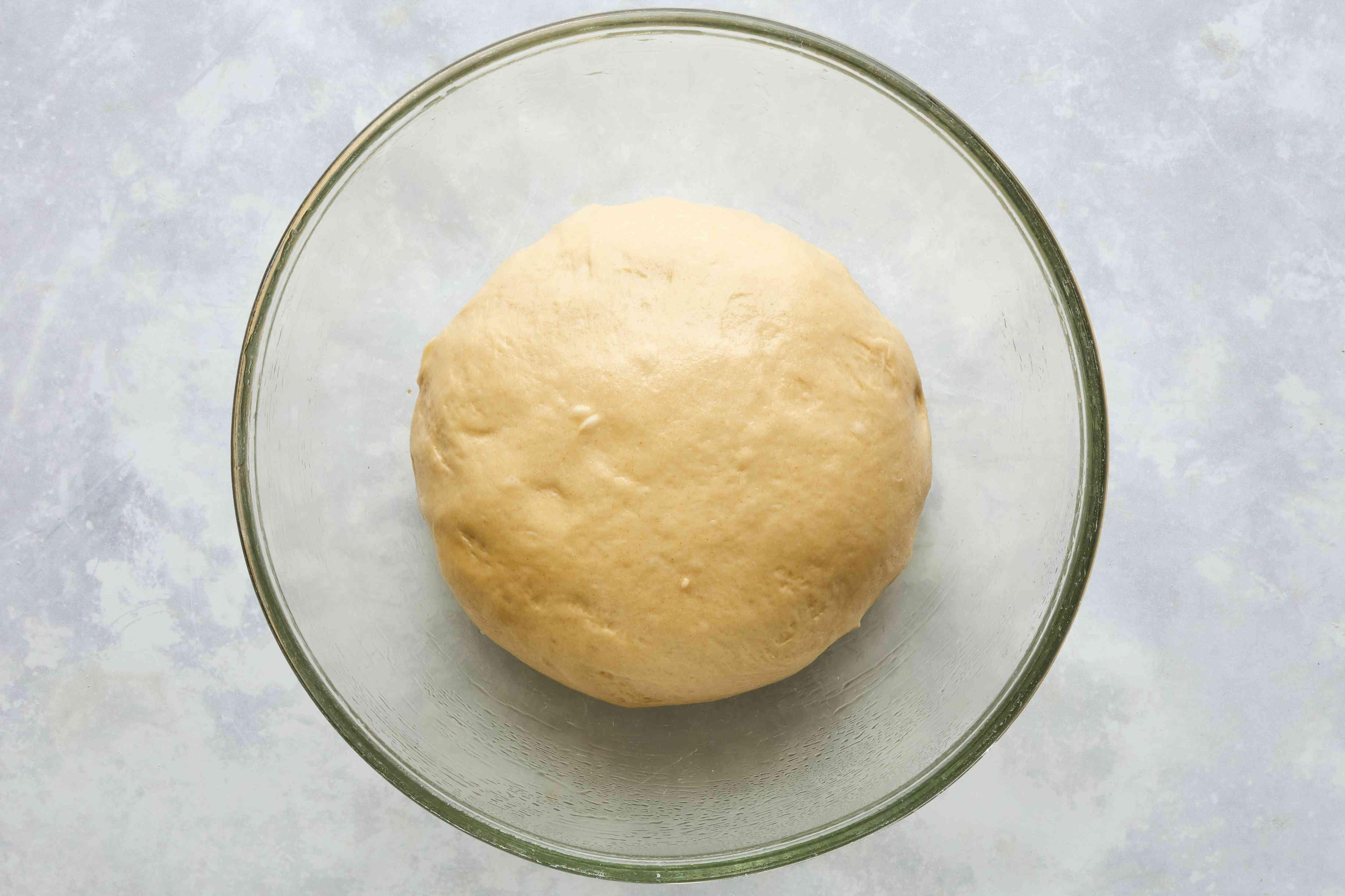 dough ball in a glass bowl