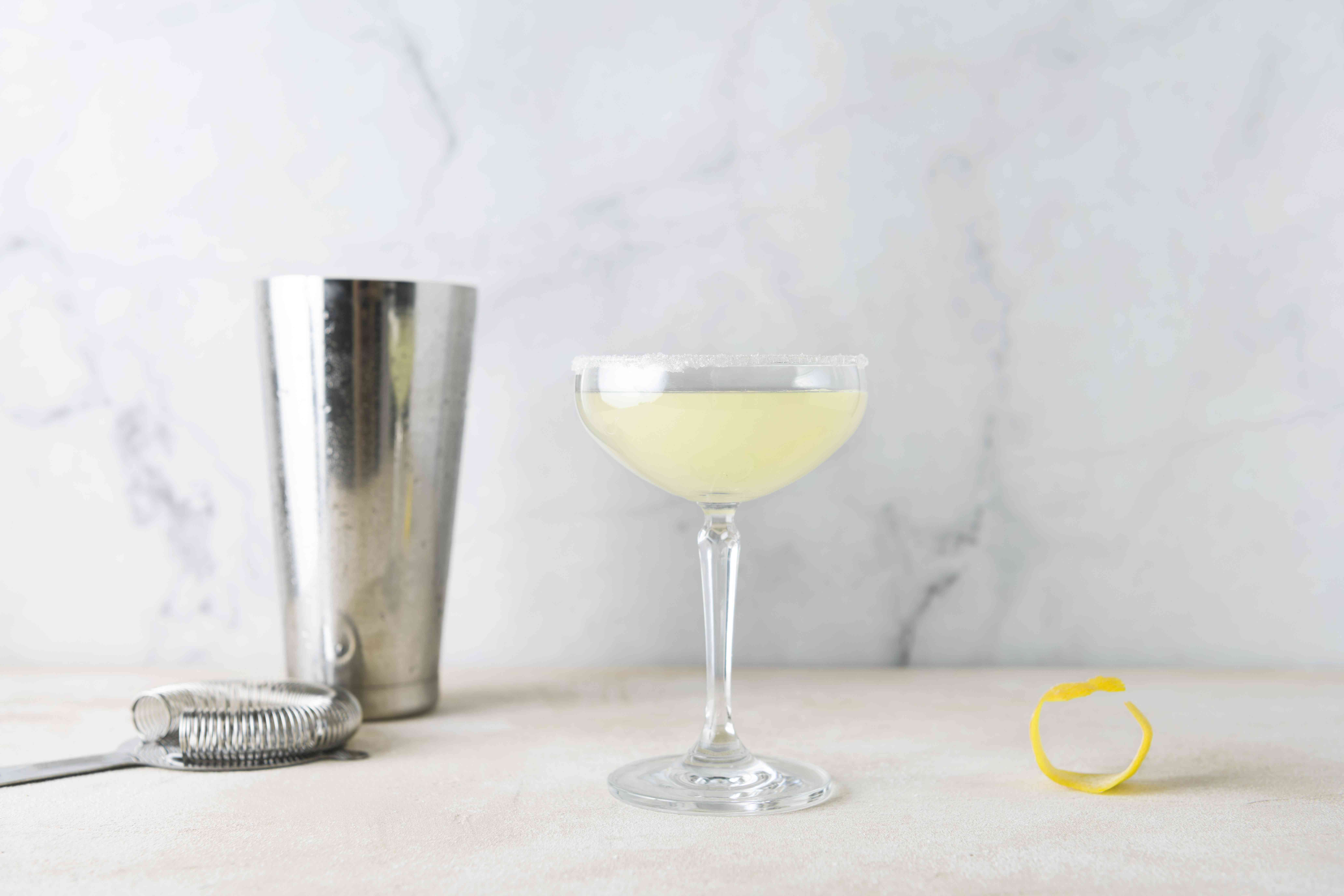 strain the cocktail into a sugar rimmed glass