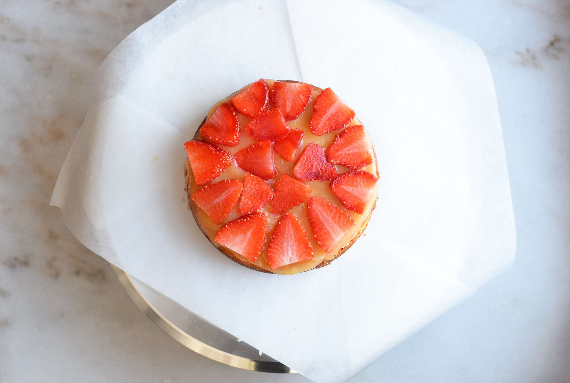 lemon curd and strawberries on top of a cake
