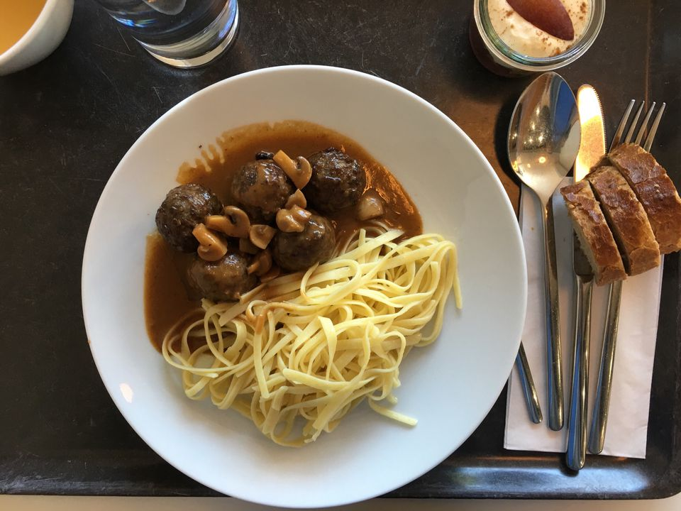 Meatballs with mushroom sauce and noodles.