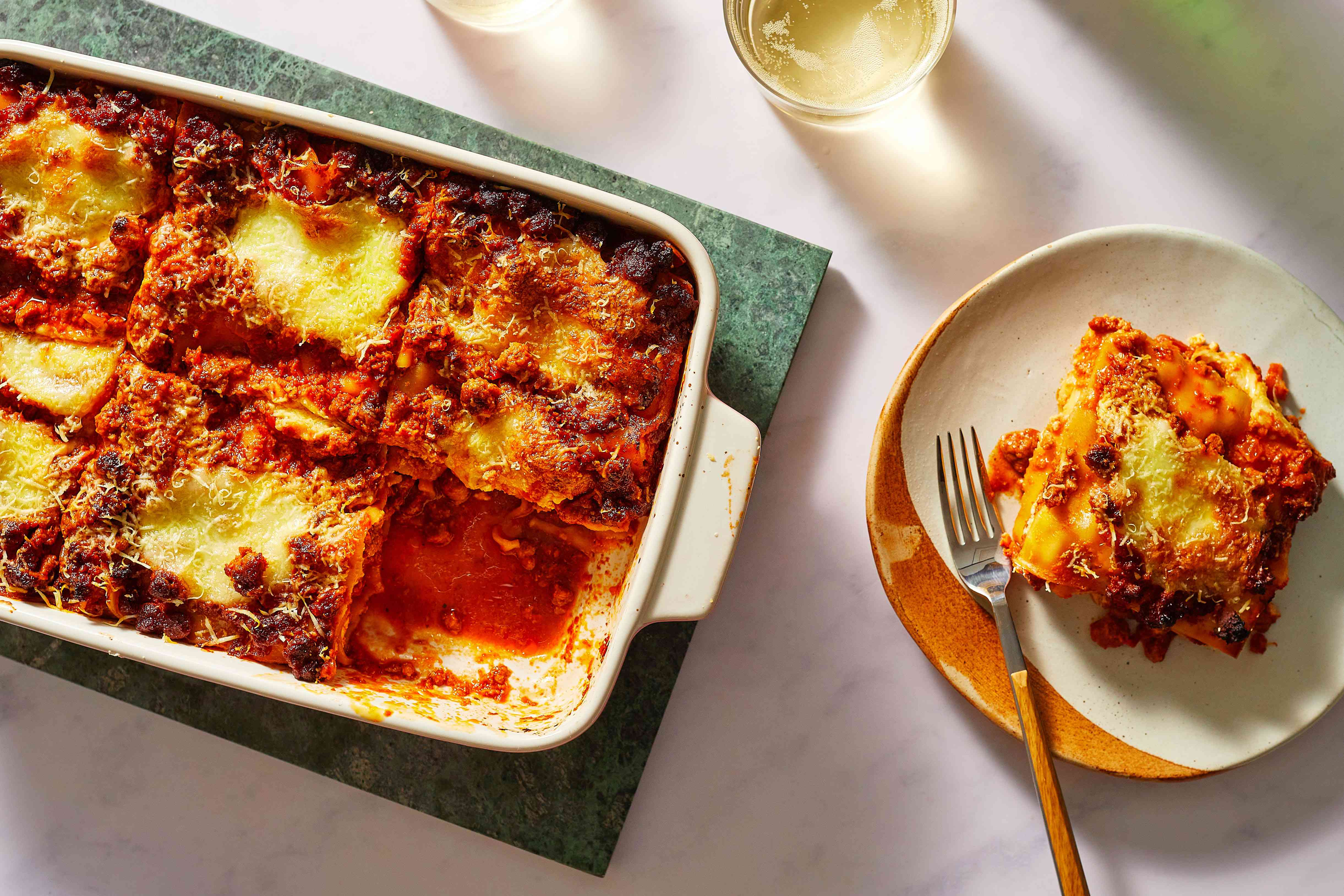 Best Classic Lasagna in a baking pan, on a plate