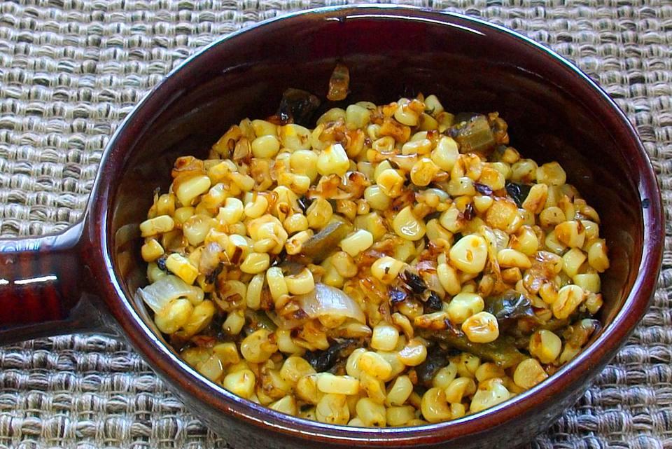 Corn off the cob in a pan.