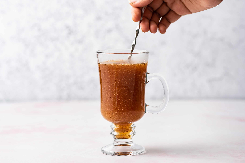 mix the hot toddy in the Irish coffee mug