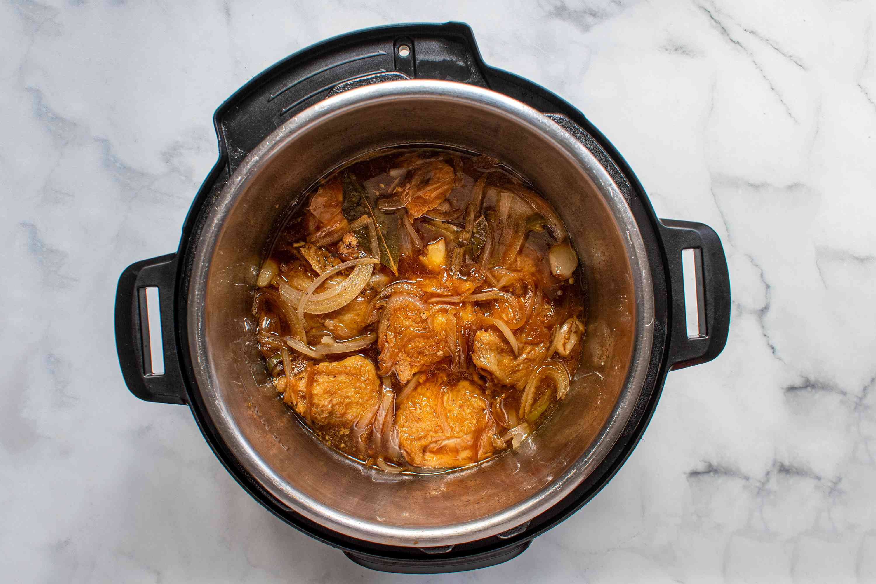 chicken adobo cooking in an instant pot