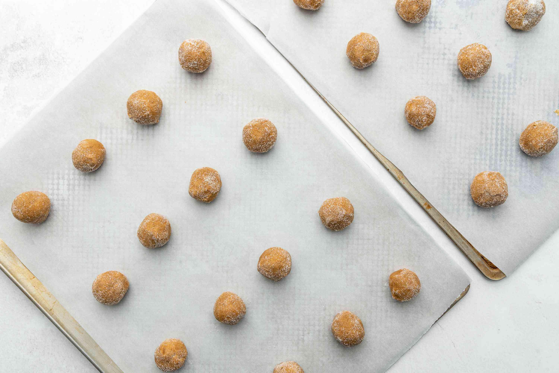 cookie dough balls on baking sheets