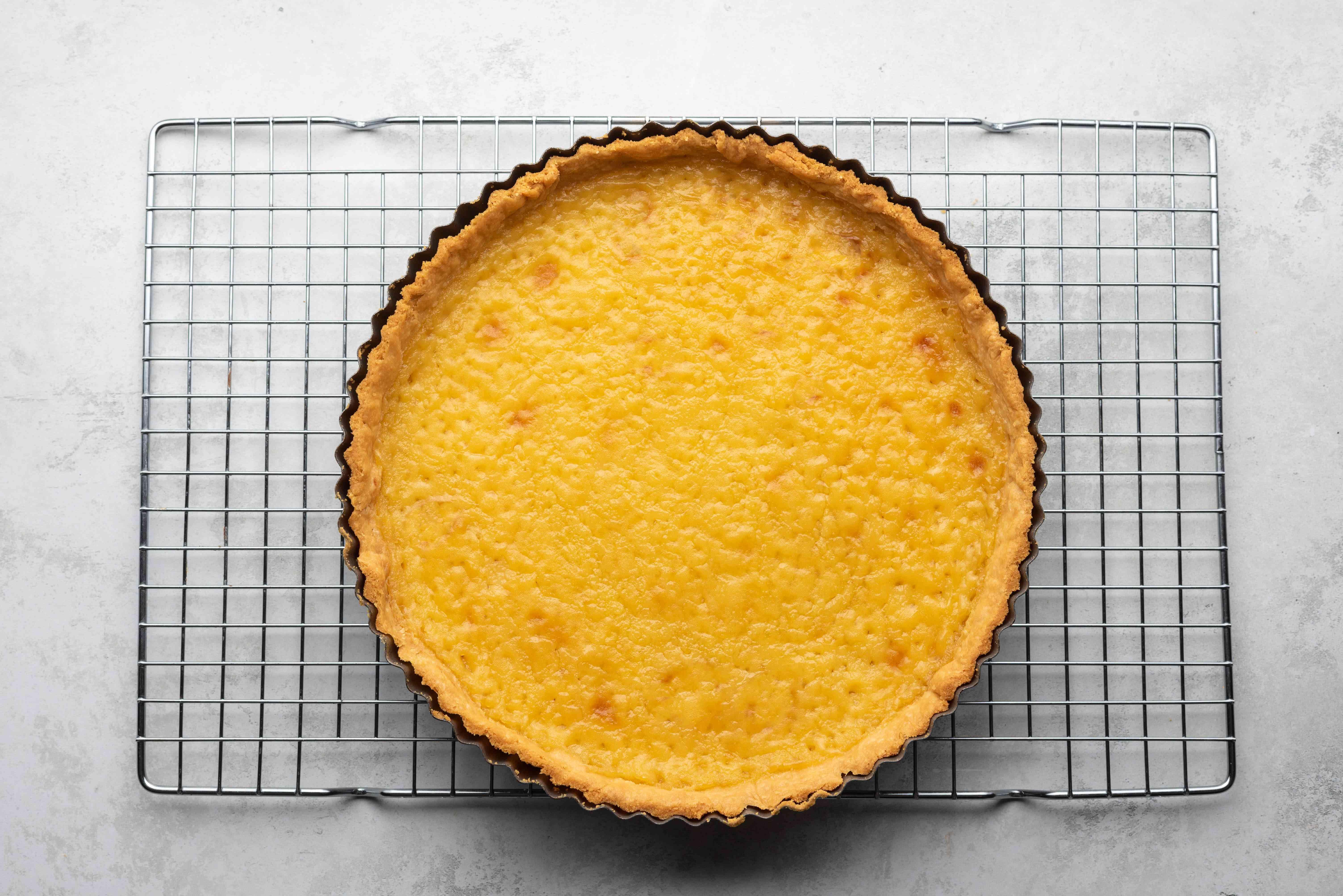 baked lemon tart on a cooling rack