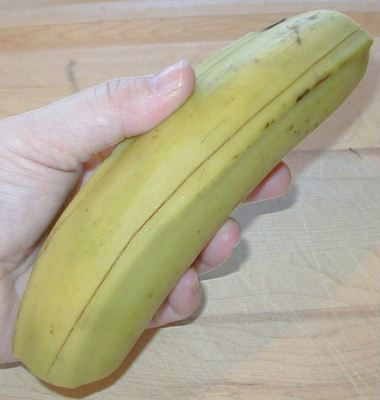 Person holding a plantain.