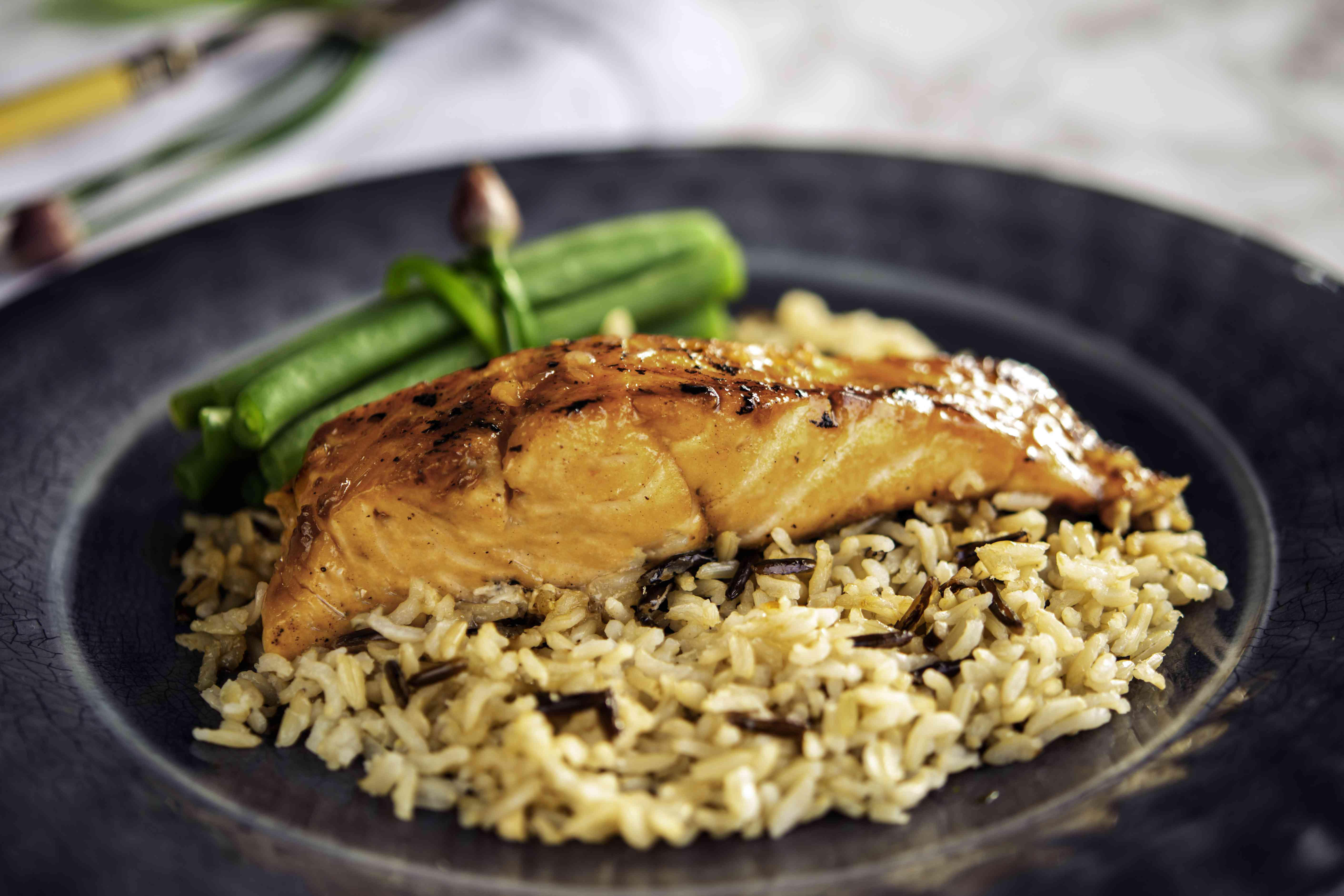 Maple glazed salmon fillet on a bed of wild rice