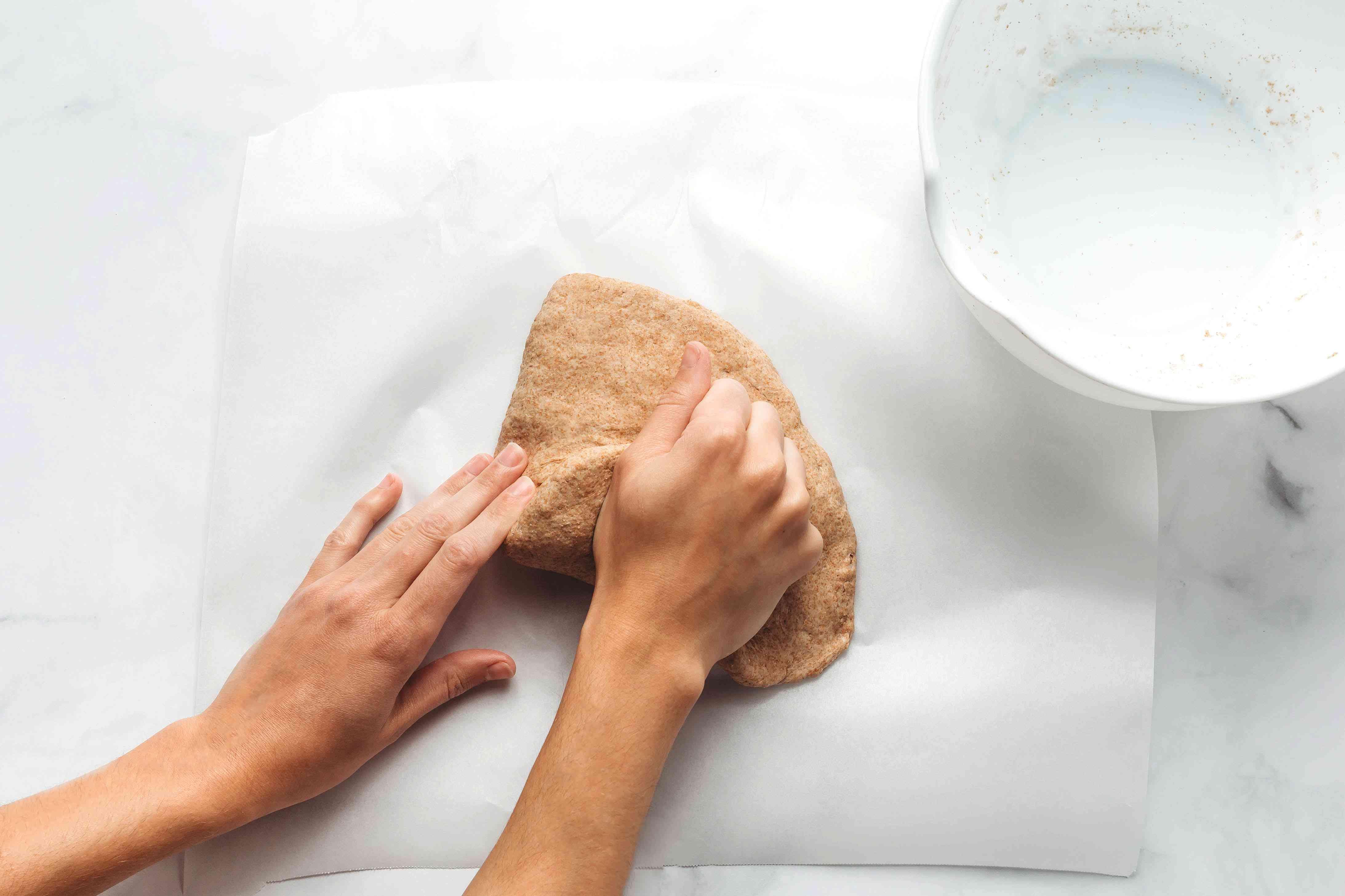 Kneading poori dough on parchment paper