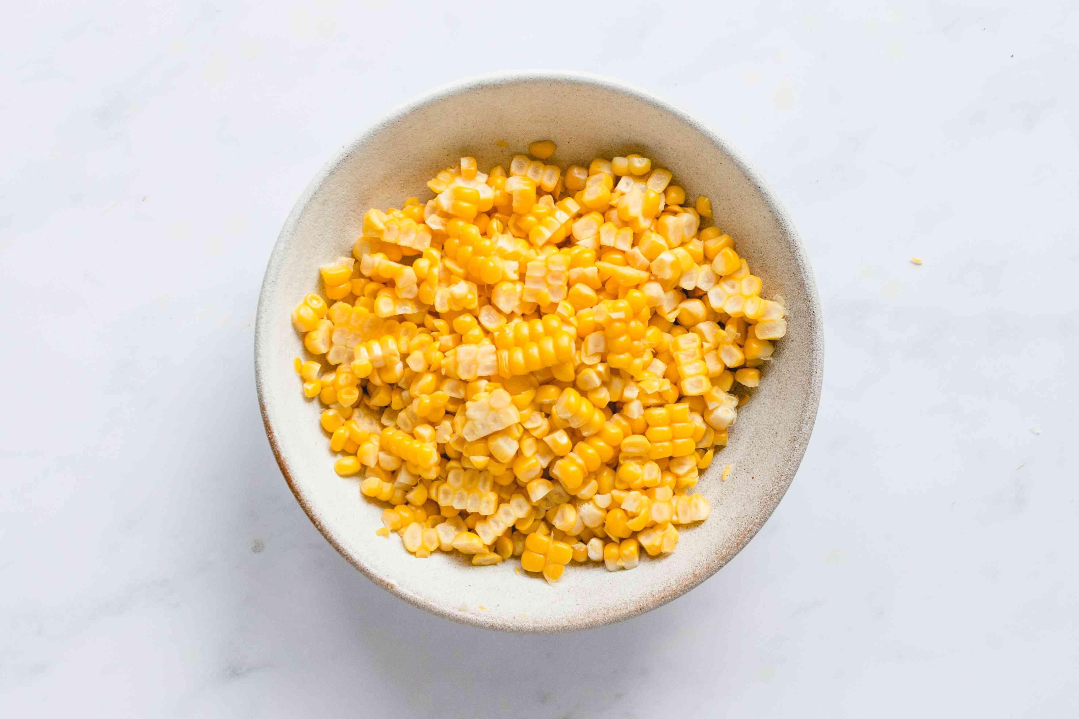 Cut corn kernels from cobs and put into a bowl