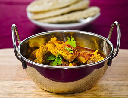 Chicken Balti Curry in a metal bowl