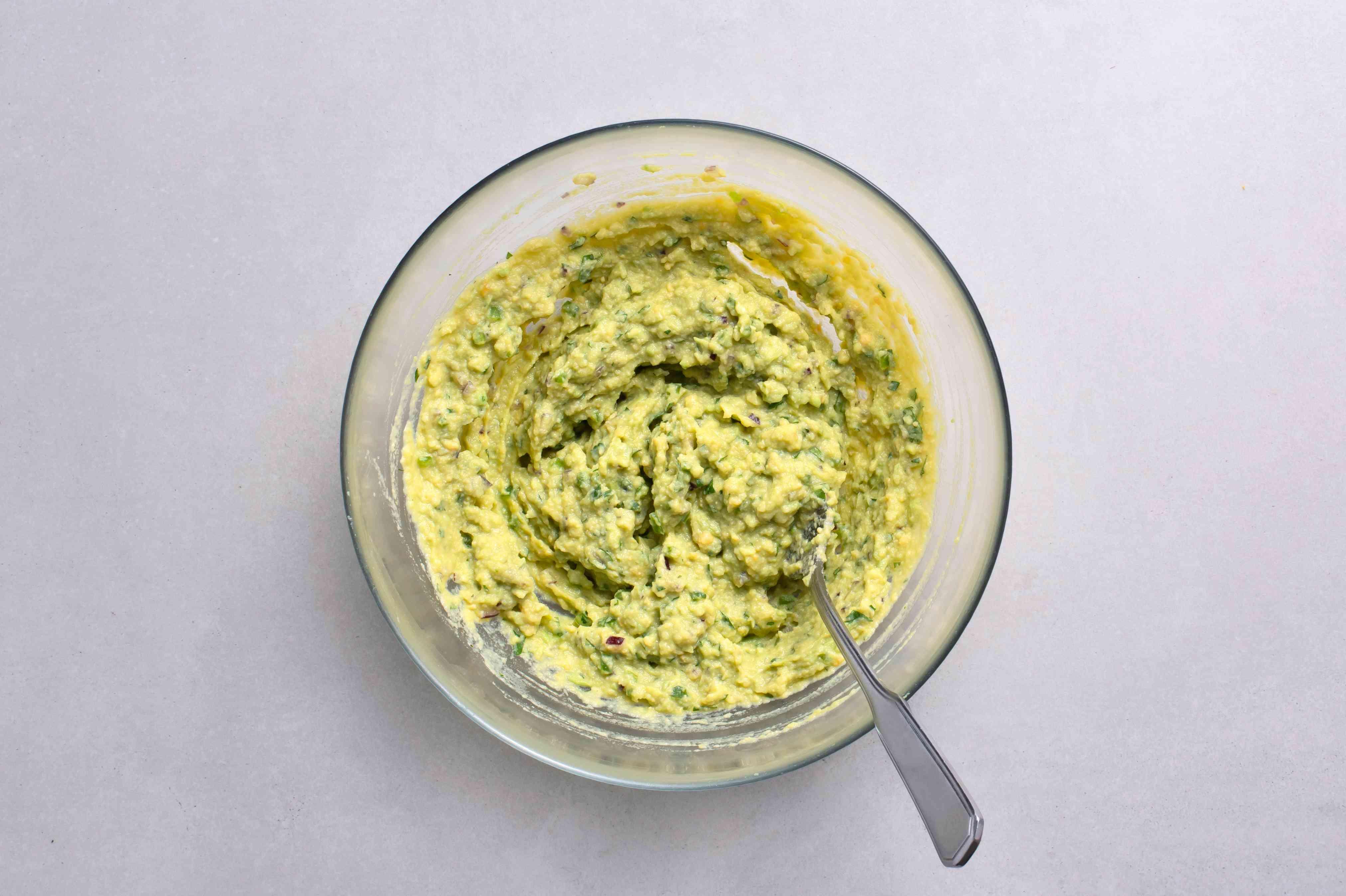 Add the mashed egg yolks, cilantro, onion, jalapeño (if using), garlic, lime juice, and salt to the mashed avocado