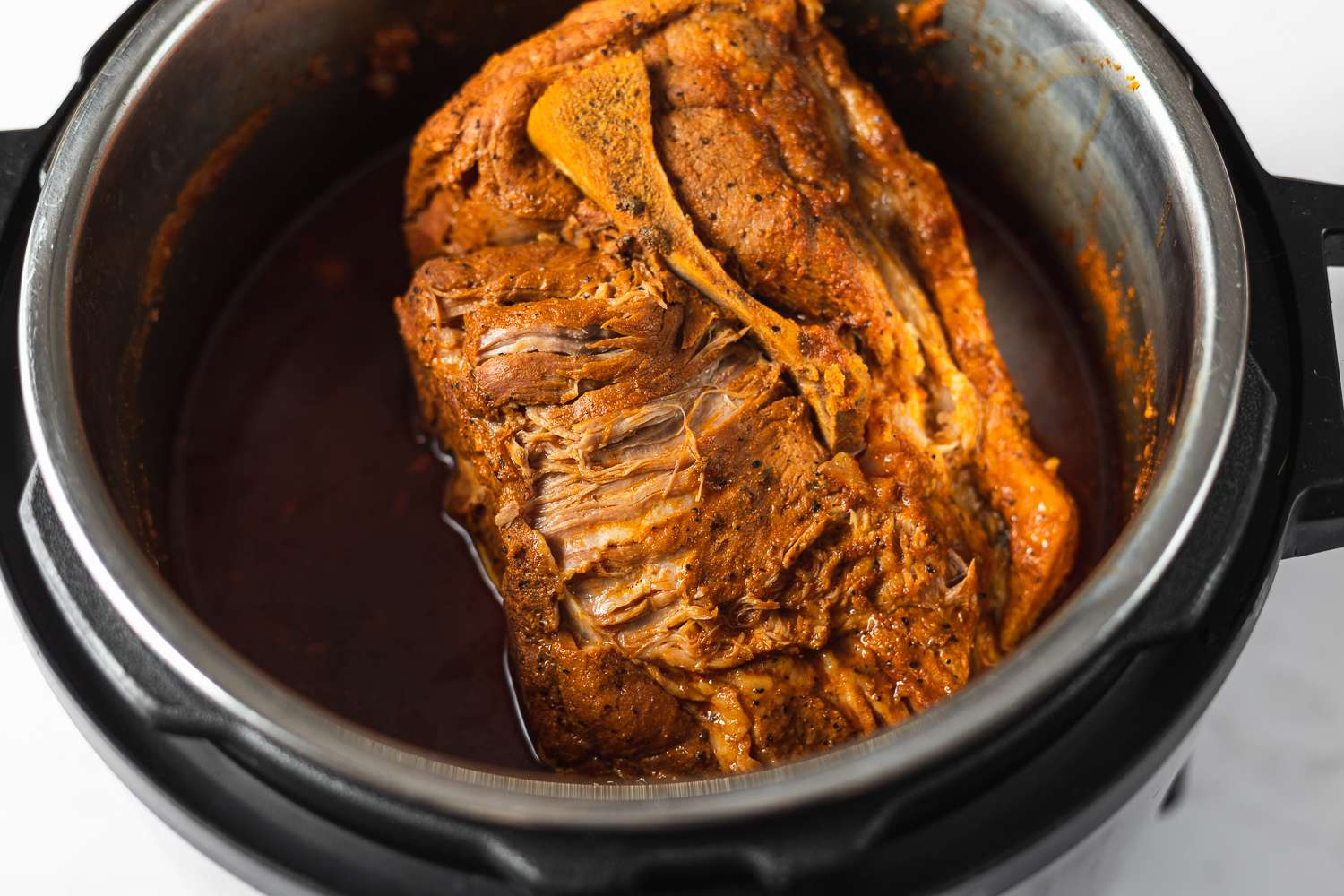 pork with marinade in an instant pot