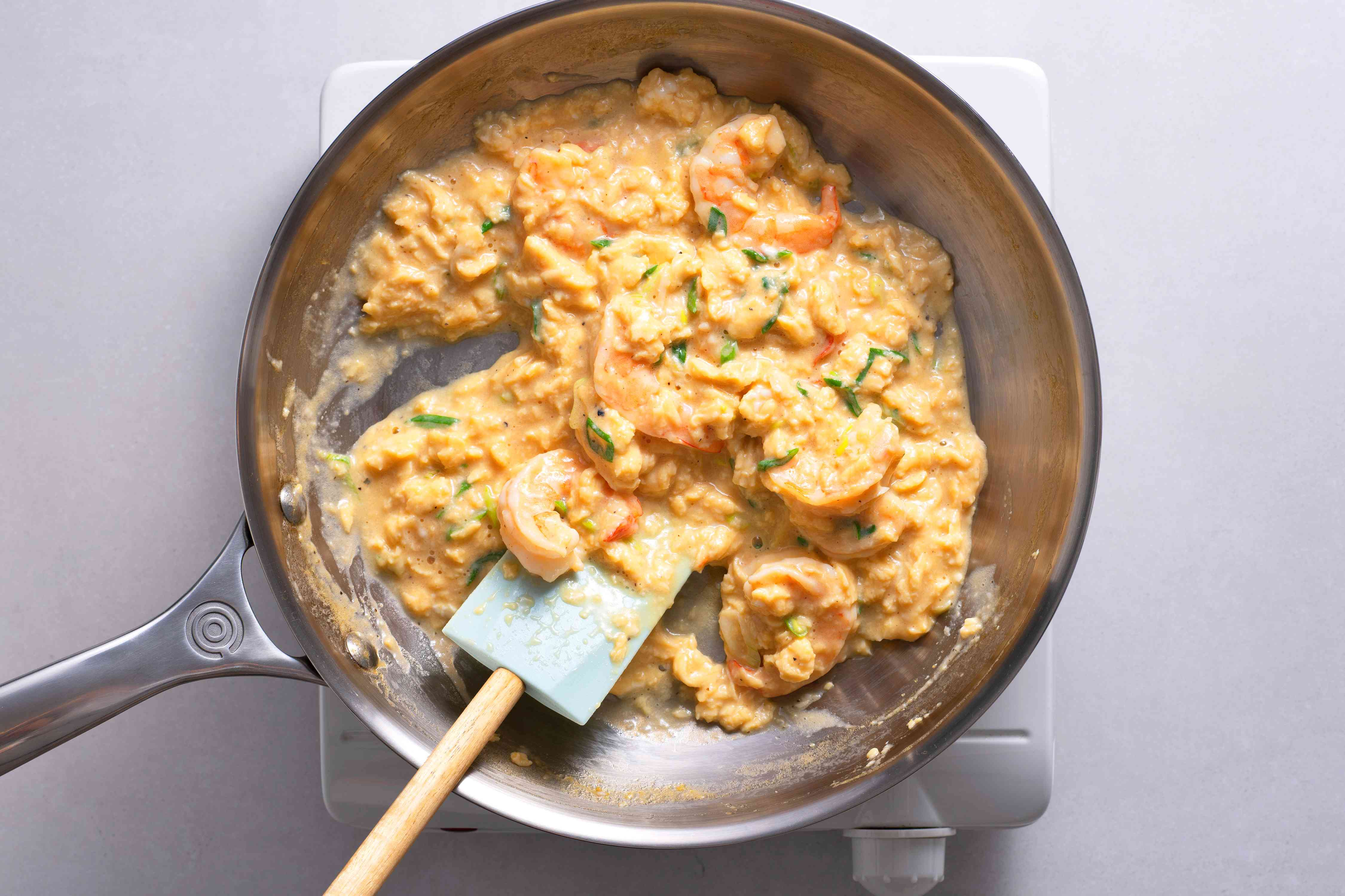 Scrambled eggs with shrimp in a pan