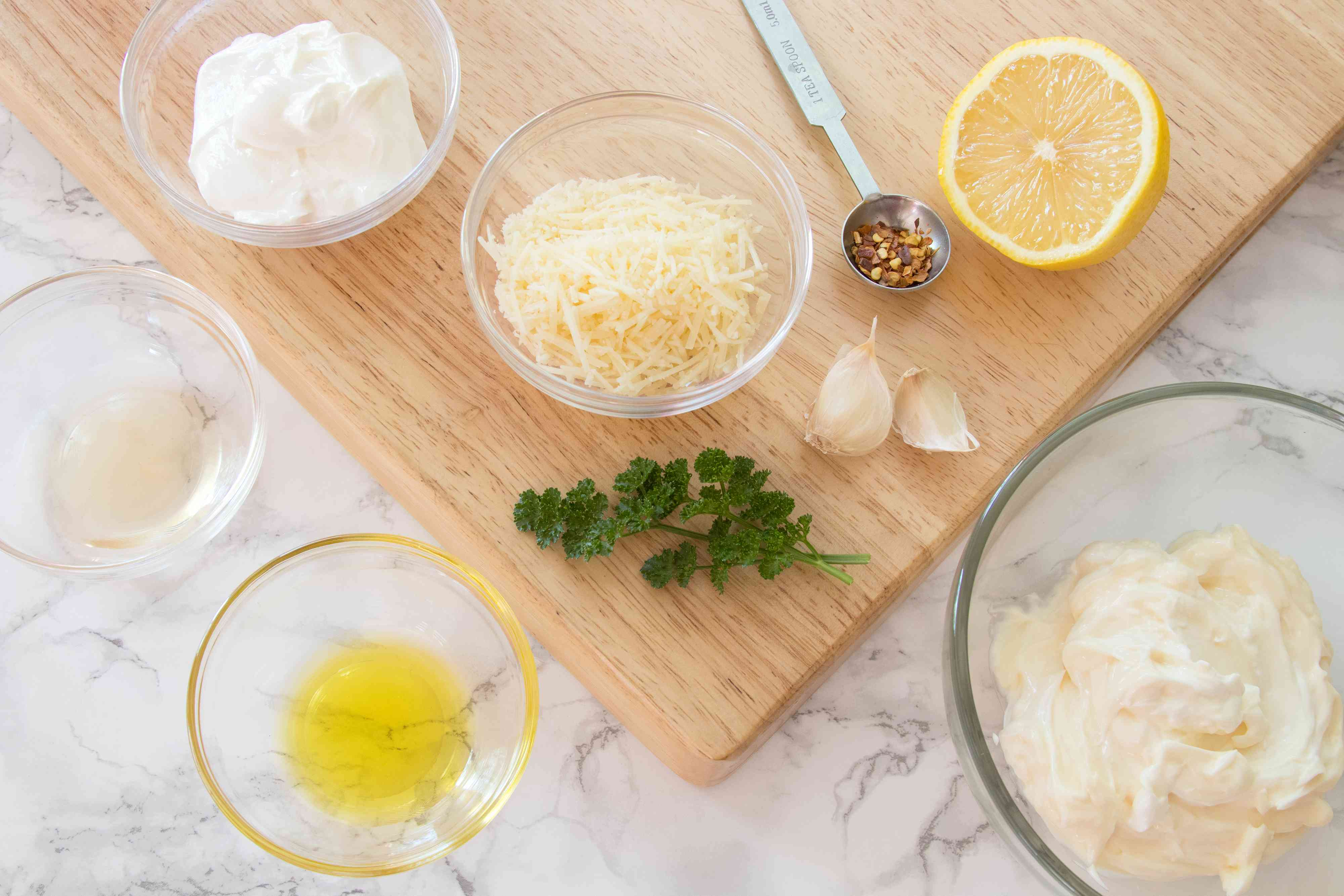 Ingredients for creamy garlic-Parmesan dipping sauce for chicken wings