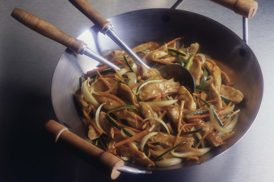 Chicken and vegetable stir-fry in wok