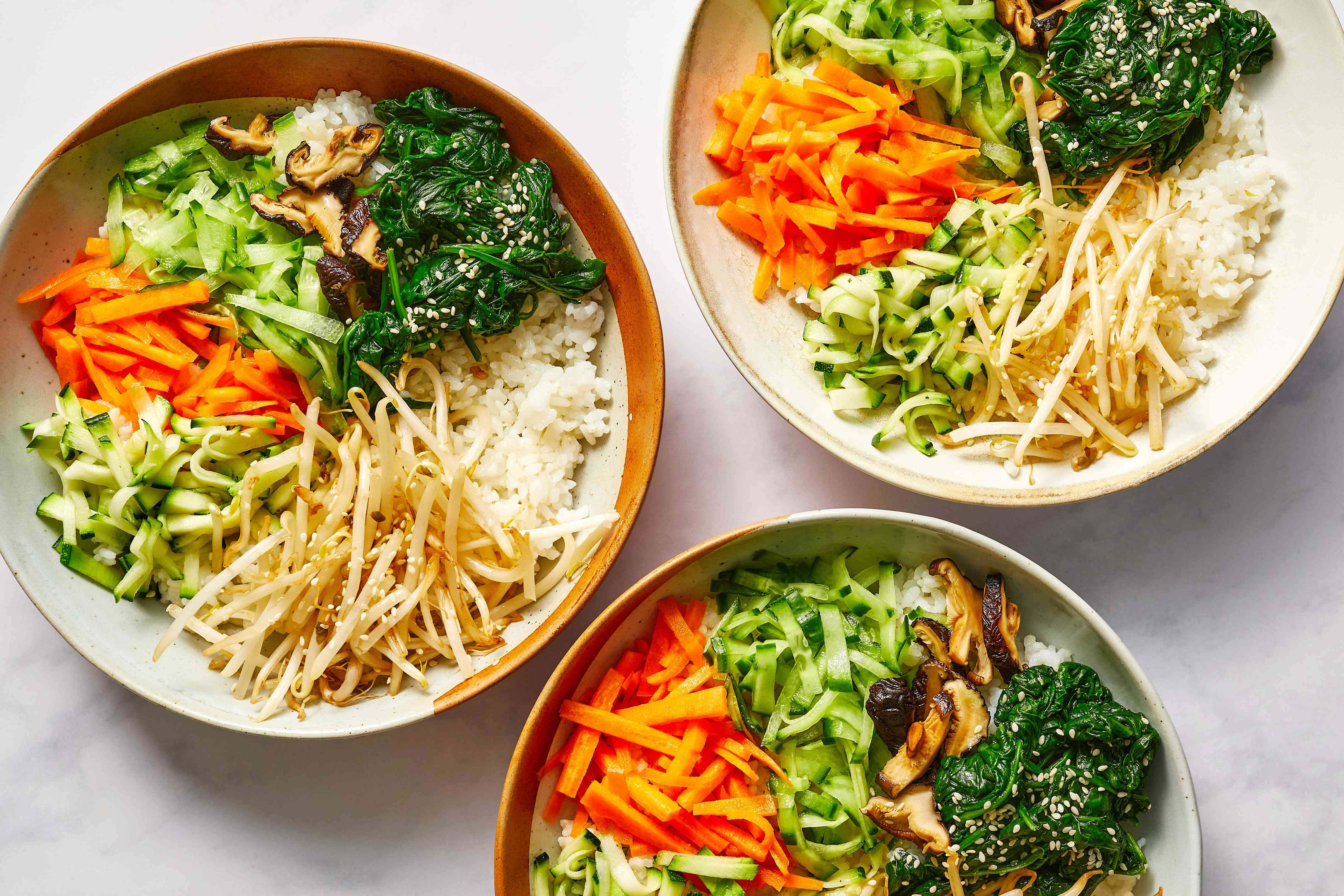 place the cooked rice in a large bowl and arrange vegetables on top