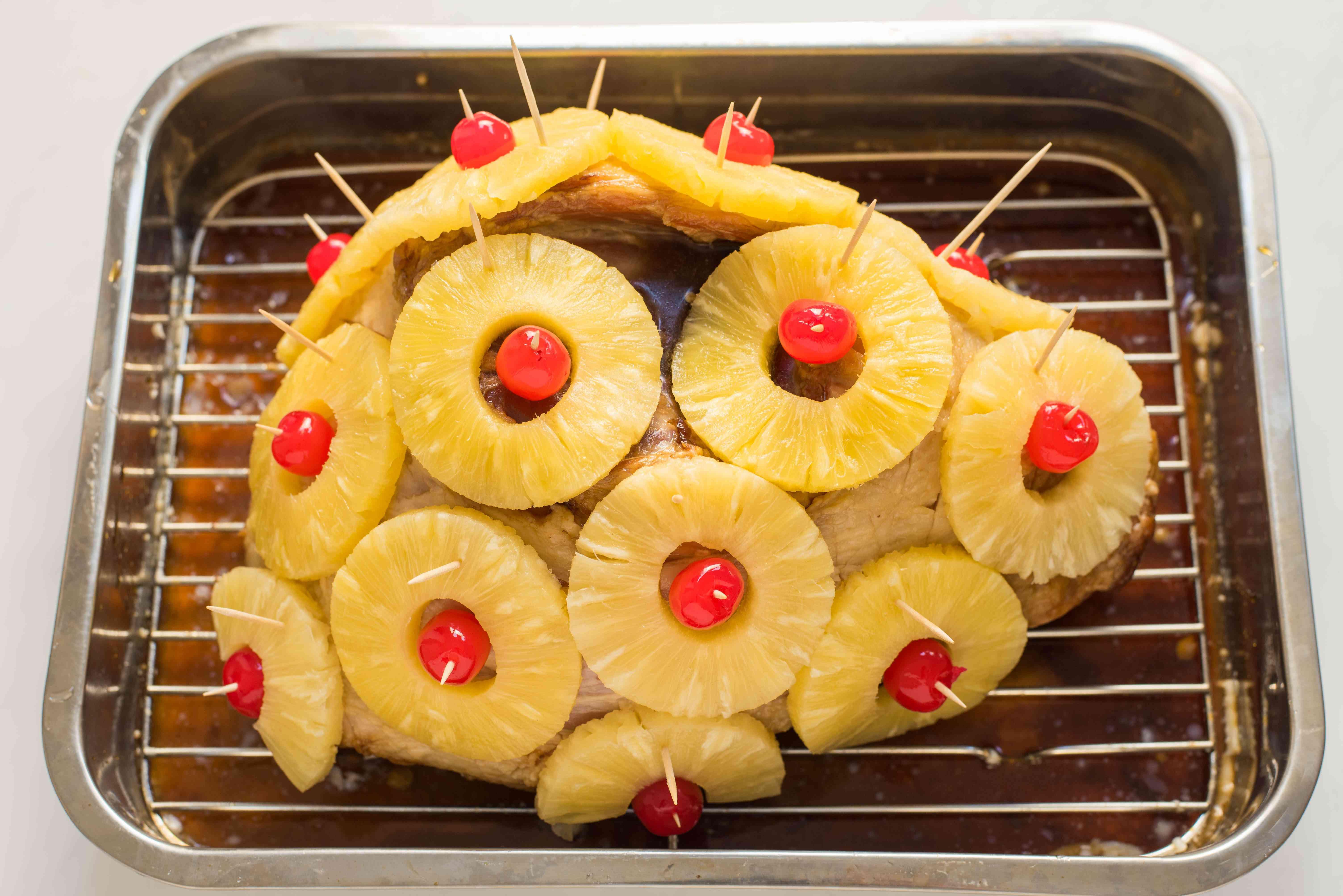 Arrange pineapple slices and cherries