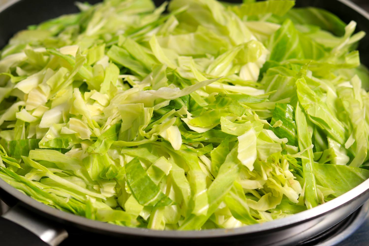 Stir in salt, cabbage, and butter
