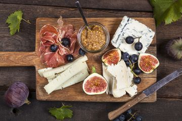 cheese board with meet and grapes