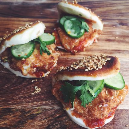 Chicken katsu steamed buns with pickles, cilantro and chili paste