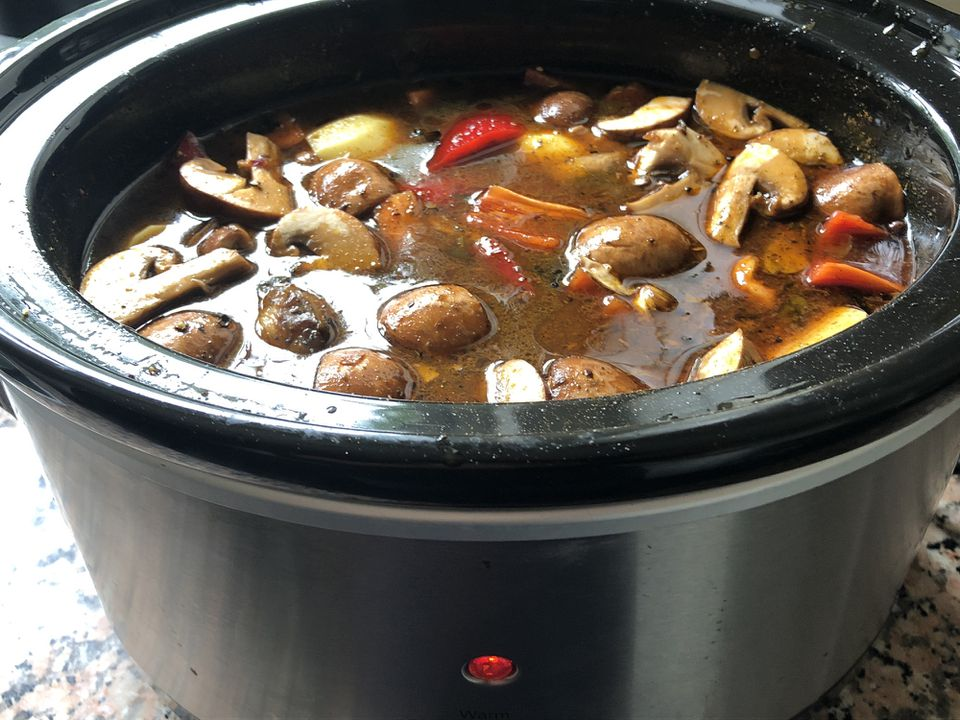 Slow cooker filled with food