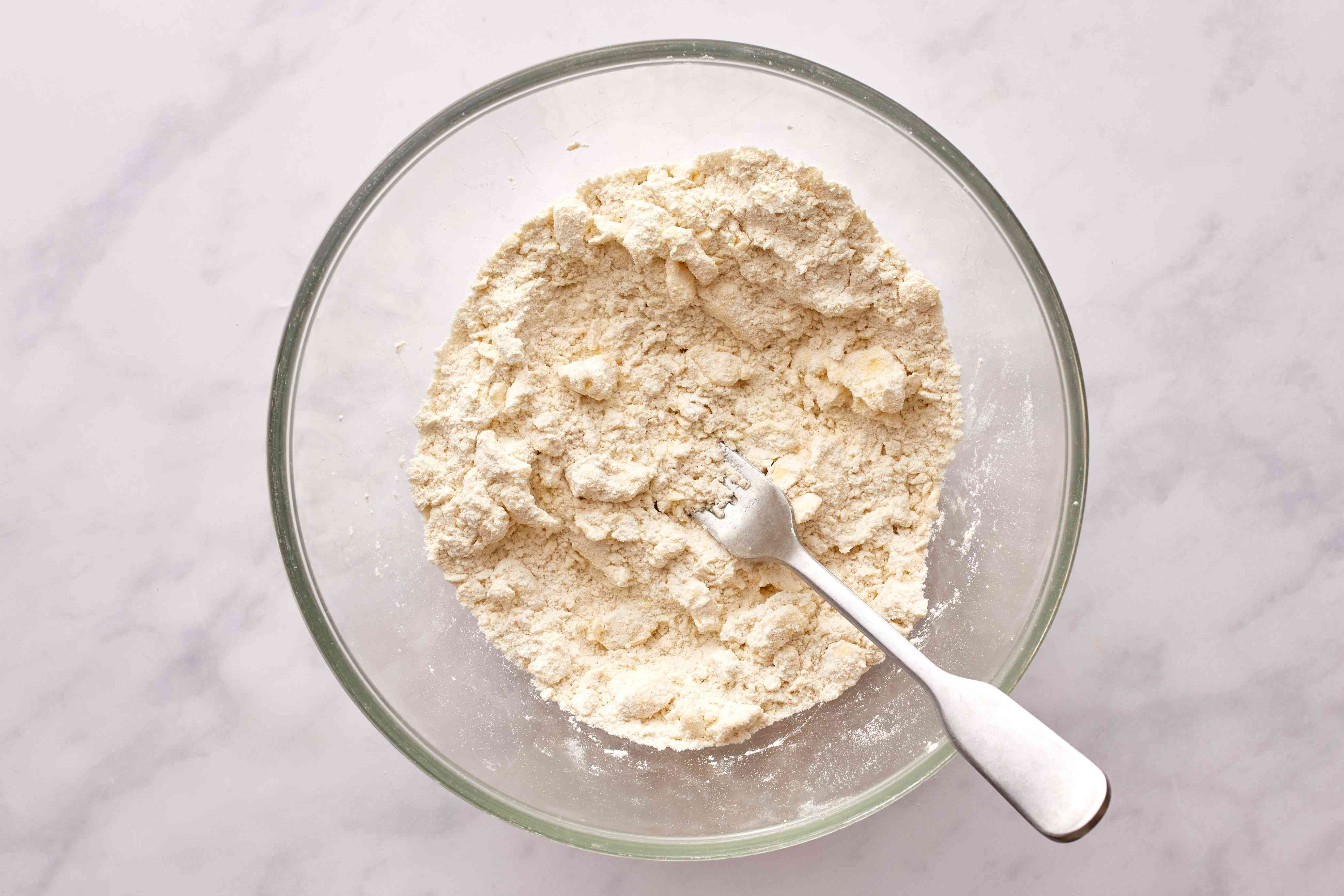 Use your fingers work the butter into the flour mixture