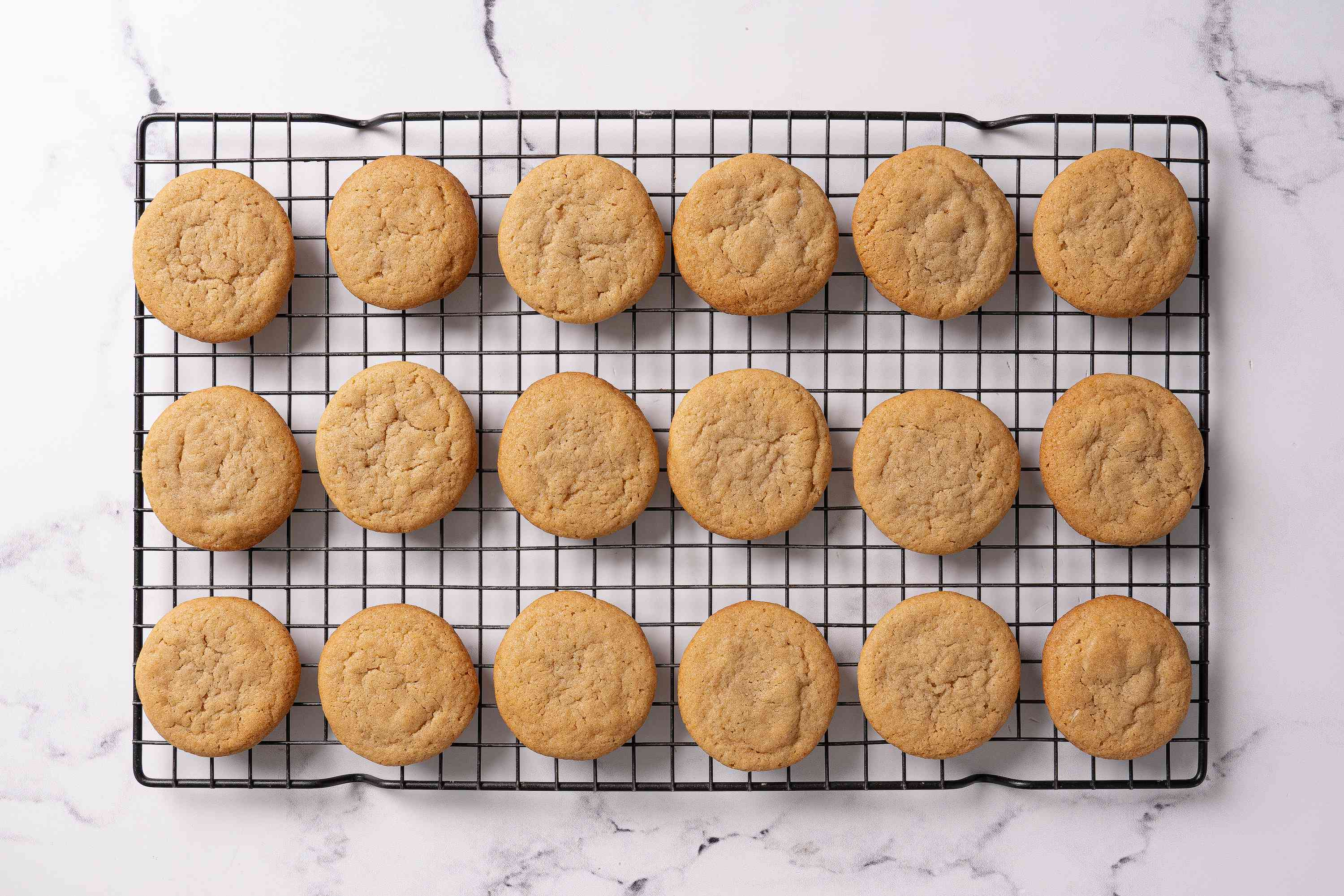 Salted caramel cookies cooling on a rack