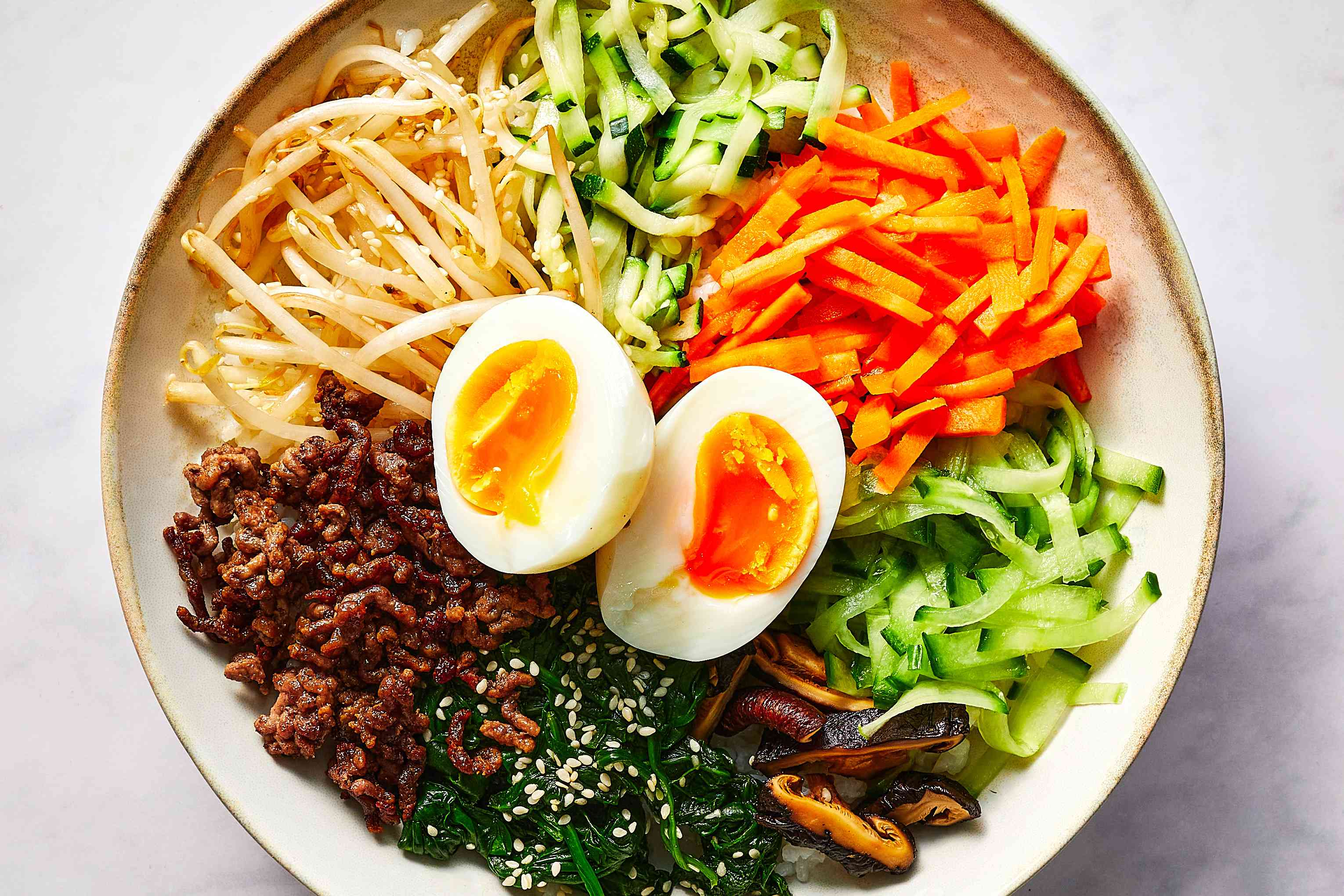 add egg to the bibimbap in the bowl