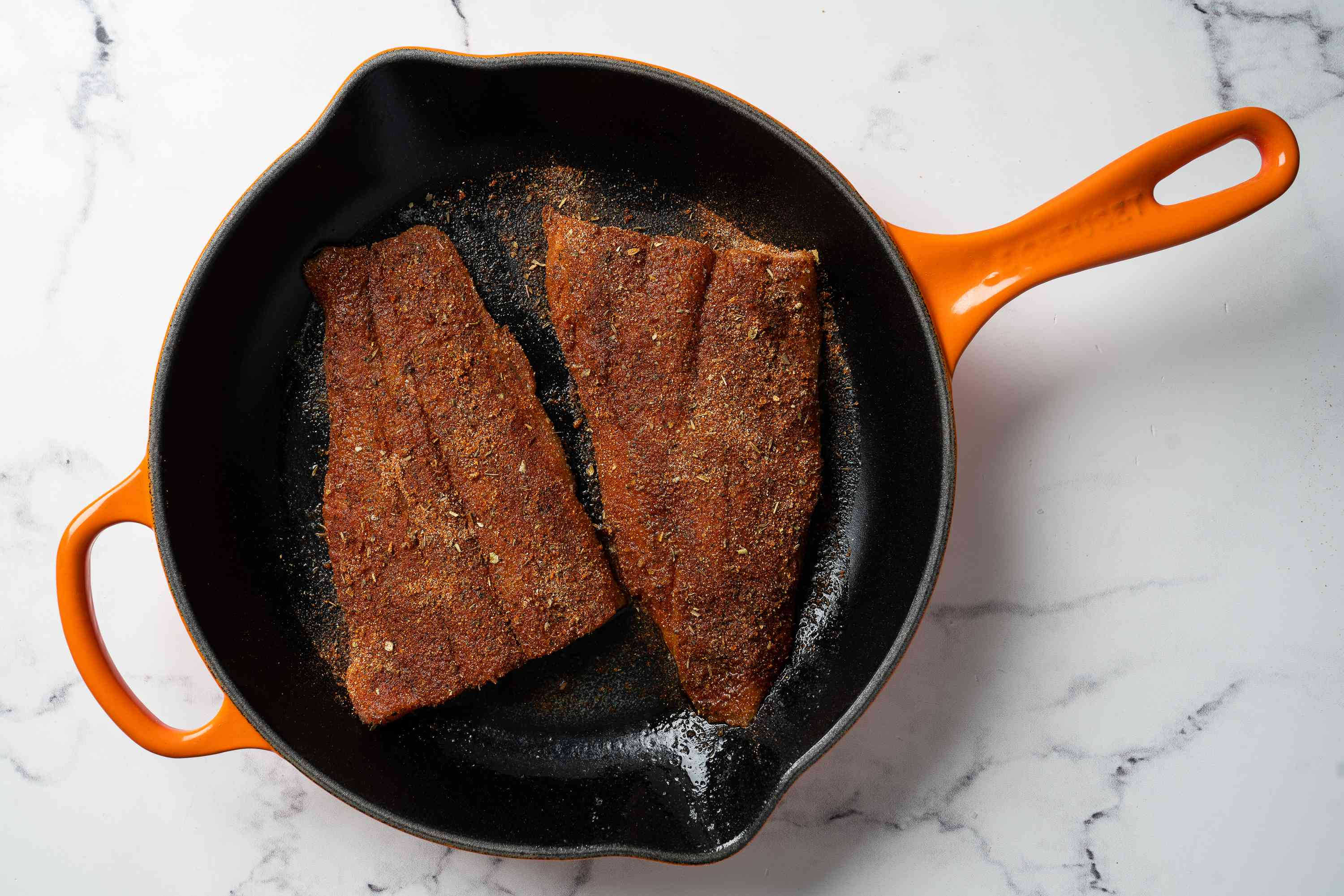 Blackened Catfish cooking in a pan