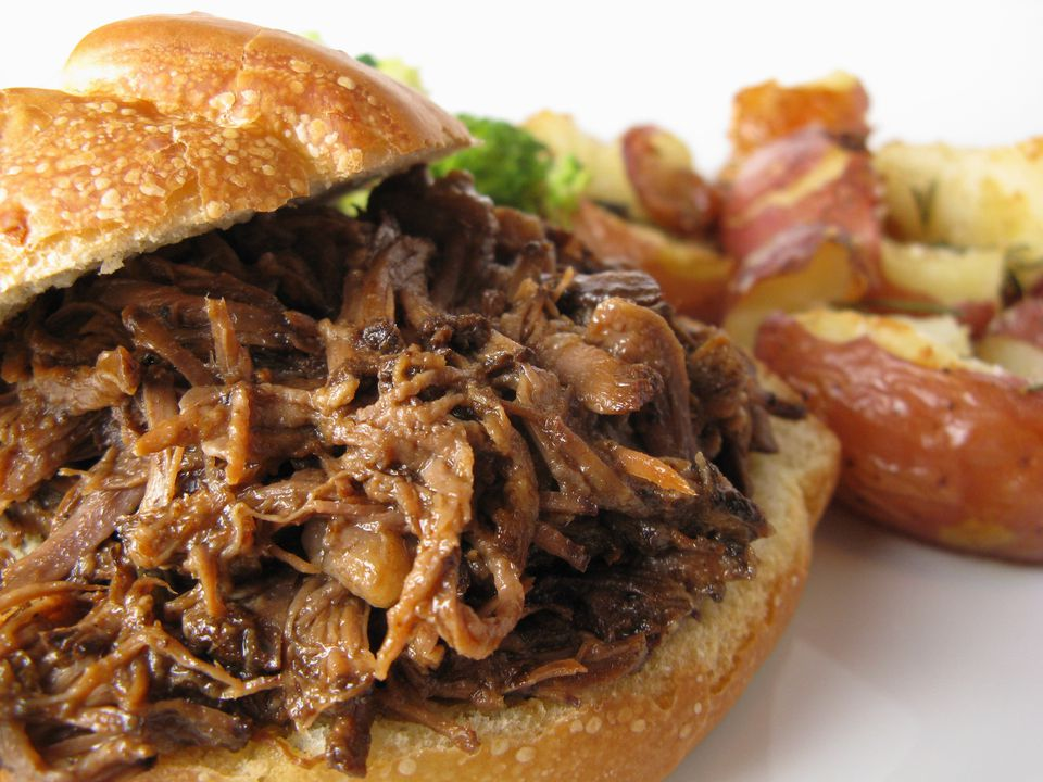 Shredded barbecue beef roast on a sandwich
