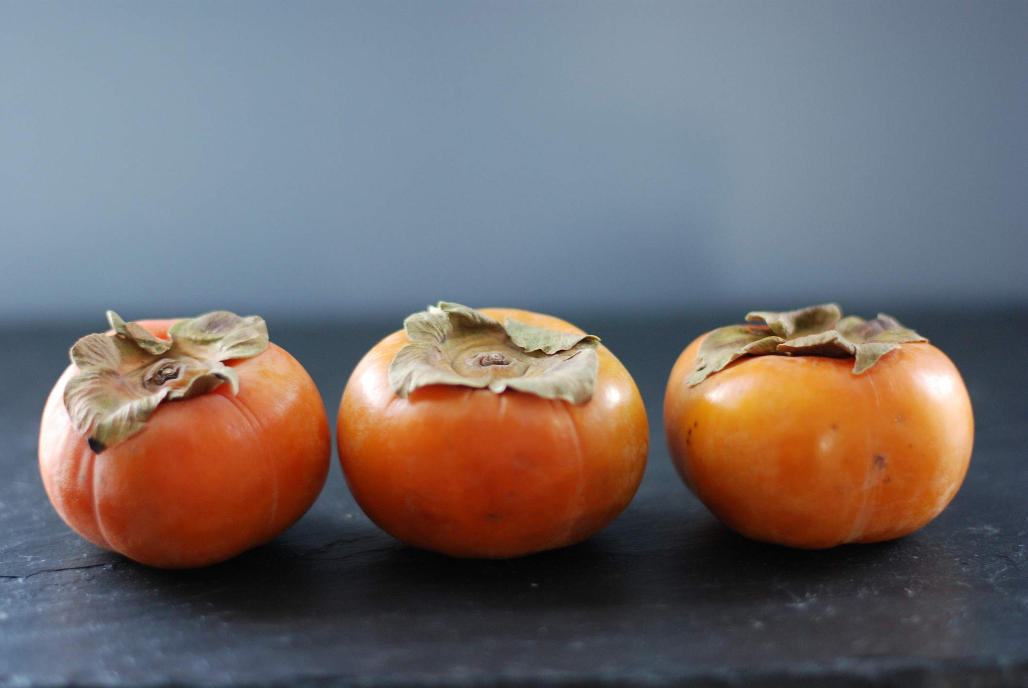 Fuyu persimmons on a counter