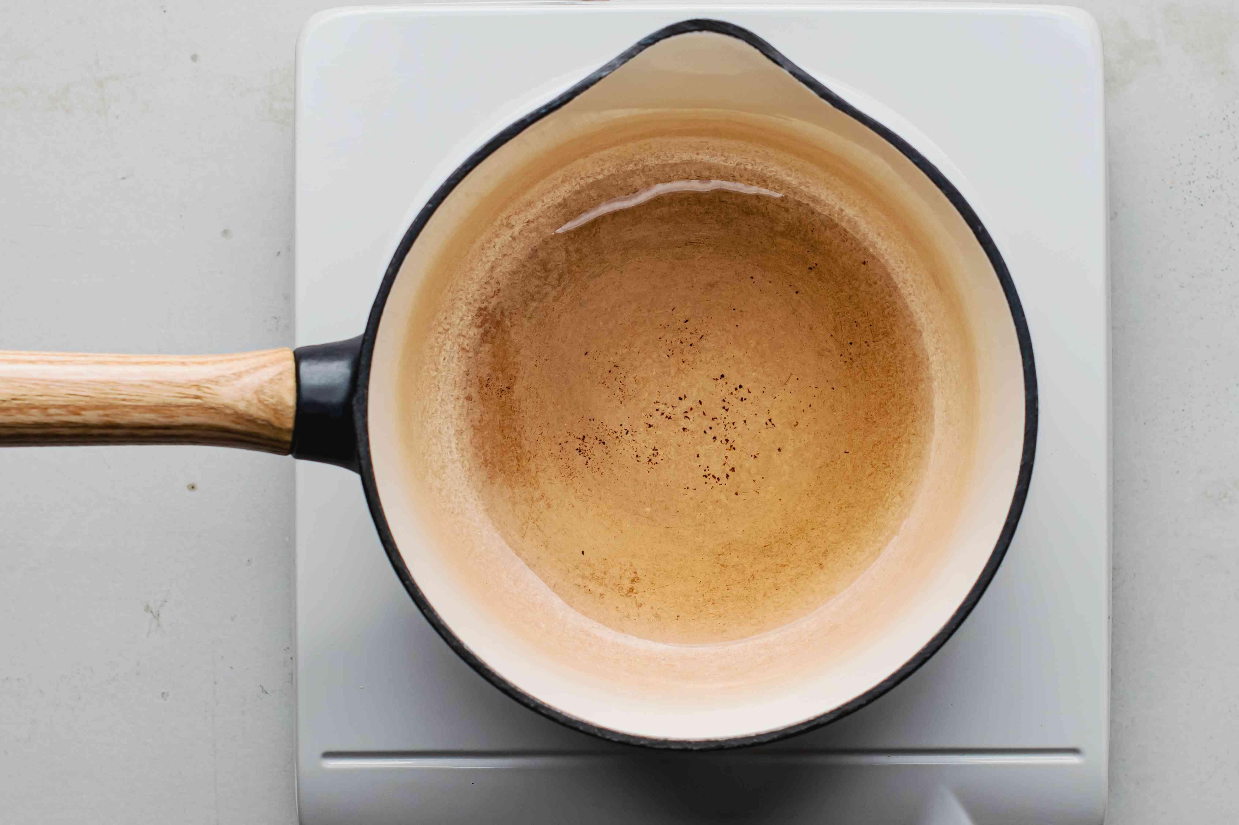 Bacon drippings in a saucepan on medium-low heat