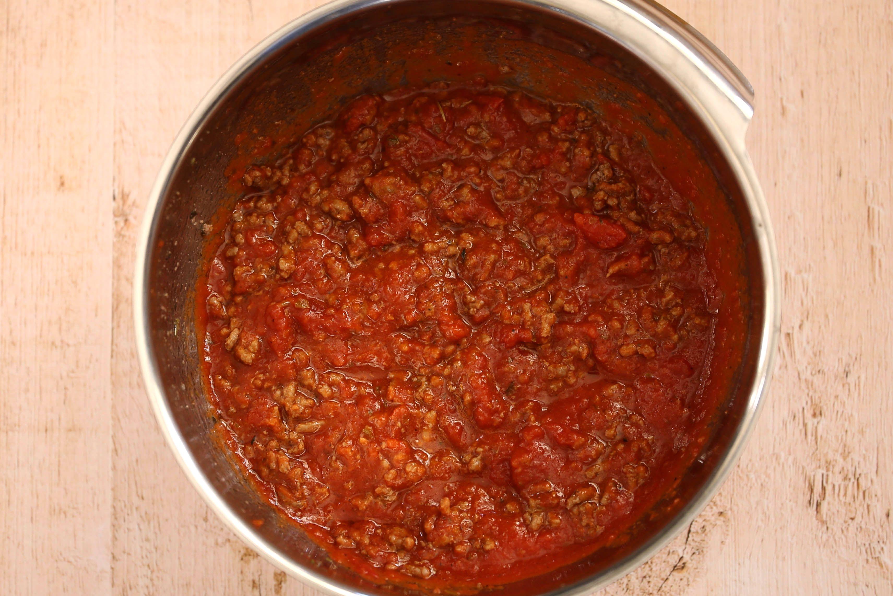 Combine the ground beef and marinara sauce.