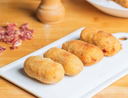 Croquetas de Jamón (Spanish ham croquettes) on a white cutting board