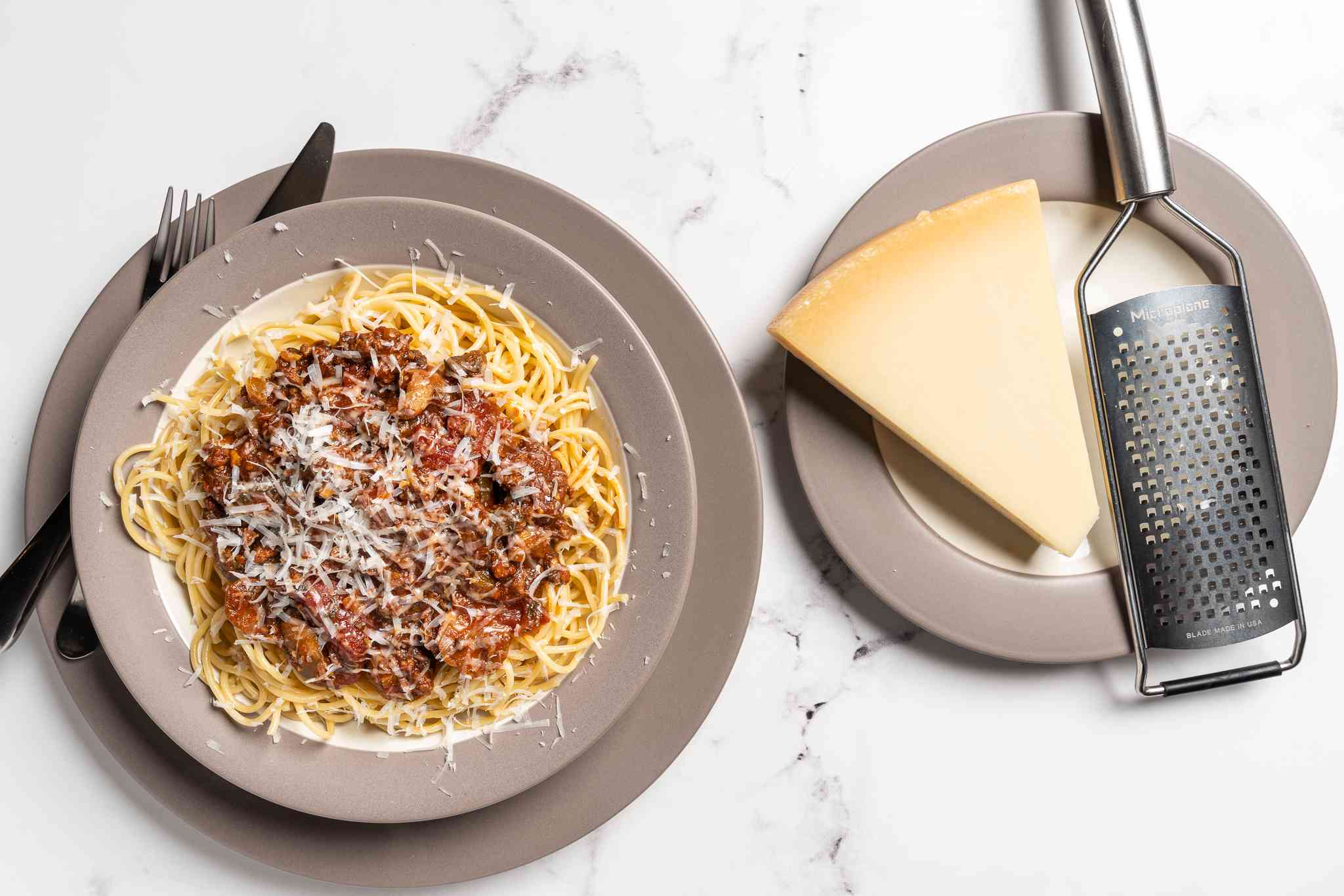 Pressure Cooker Spaghetti Sauce, served with pasta and cheese