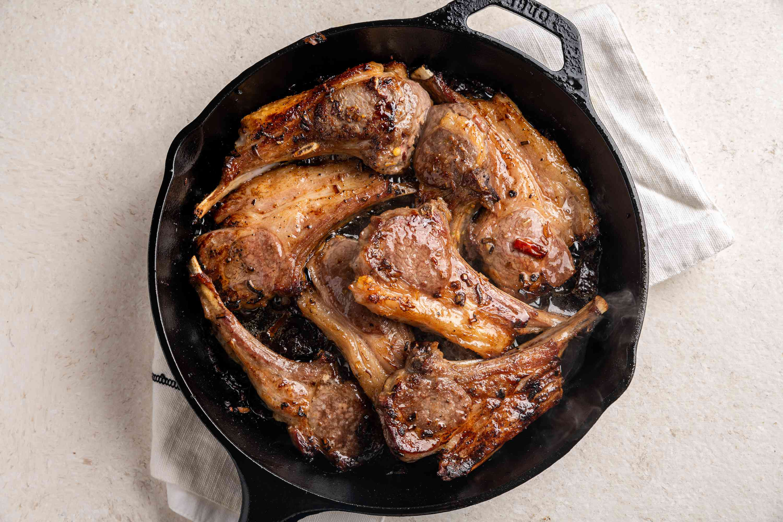 lamb chops in a frying pan