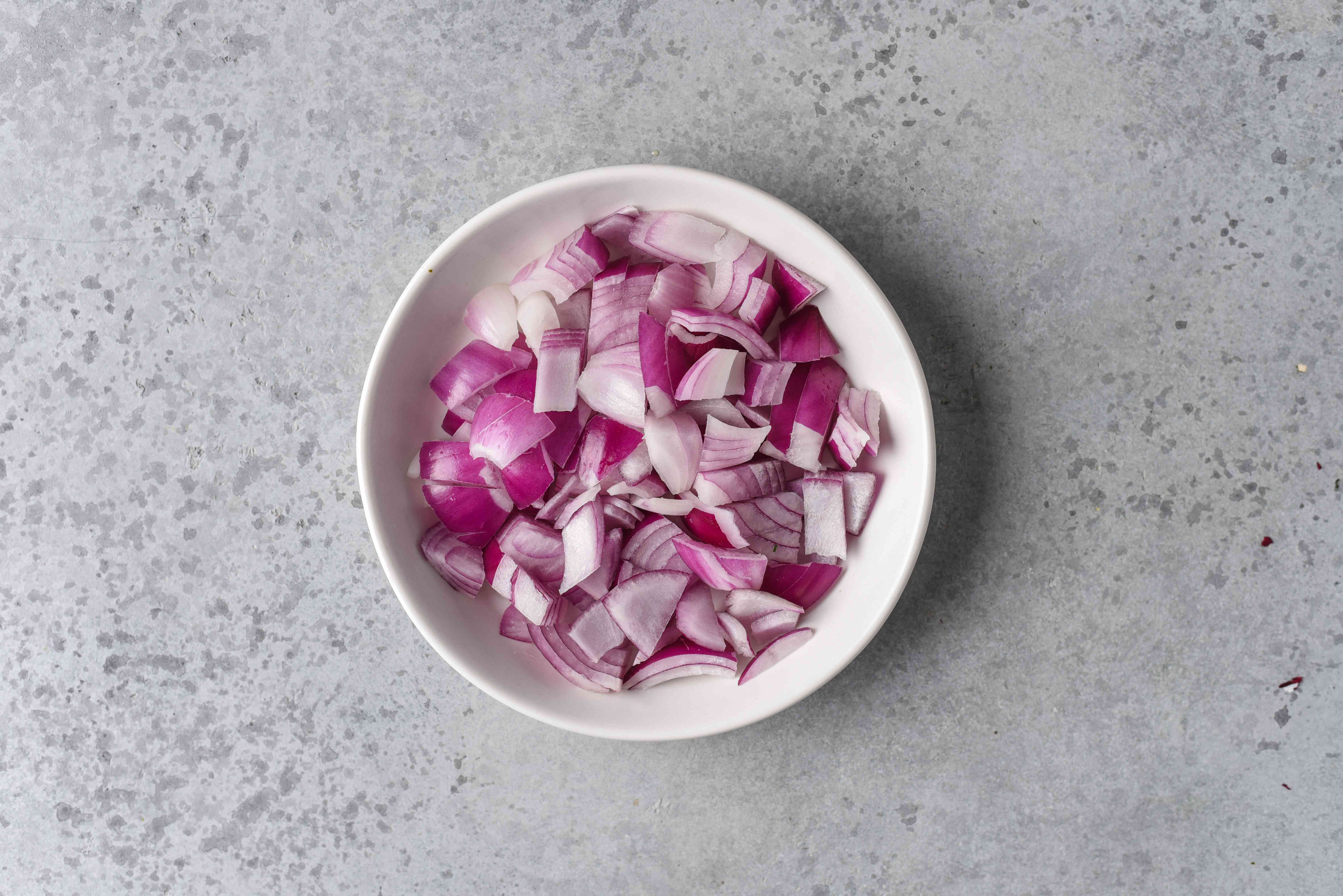 red onion pieces in a bowl