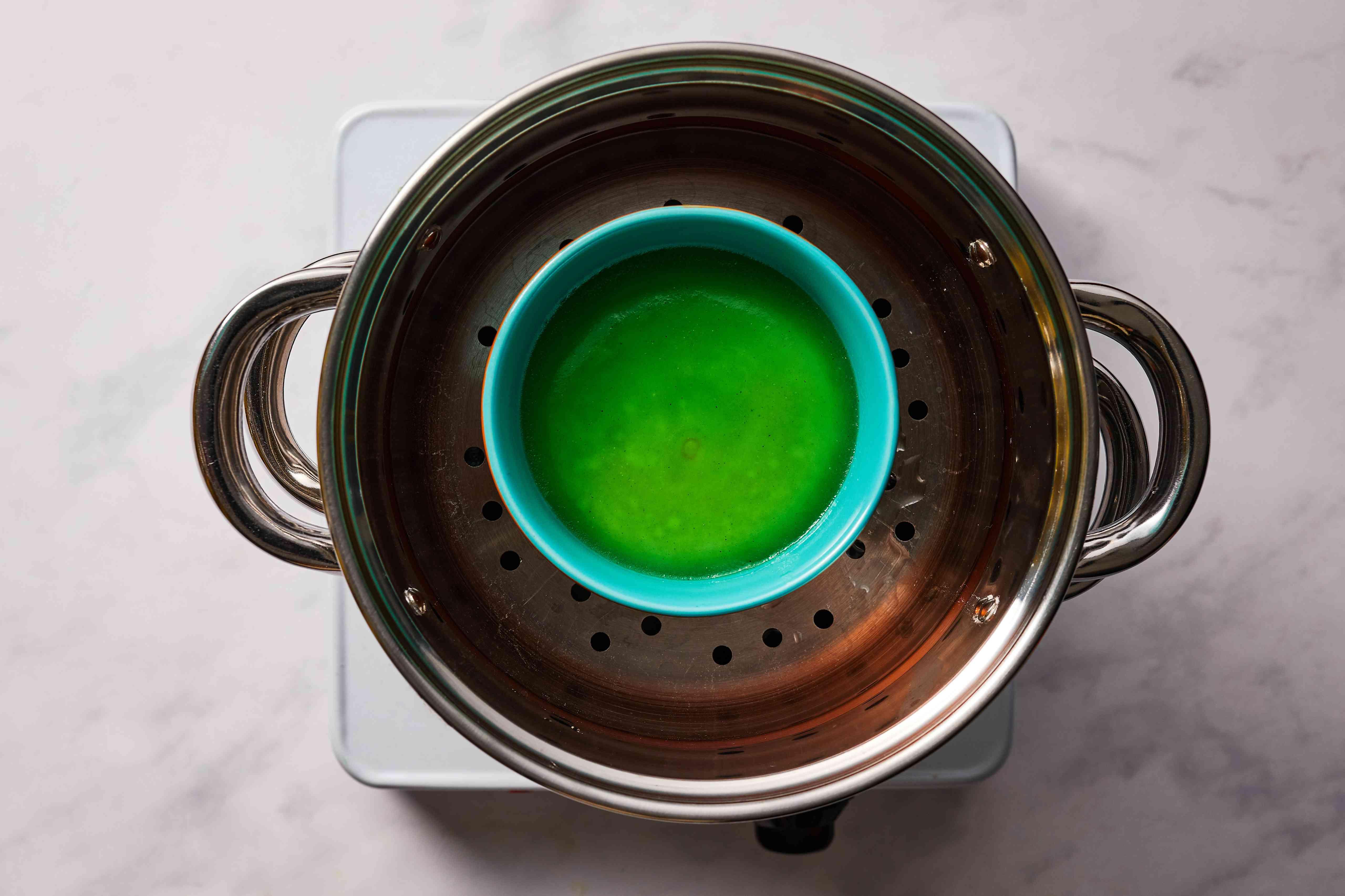 Vietnamese Pandan Rice and Mung Bean Cake in a ramekin in a steamer