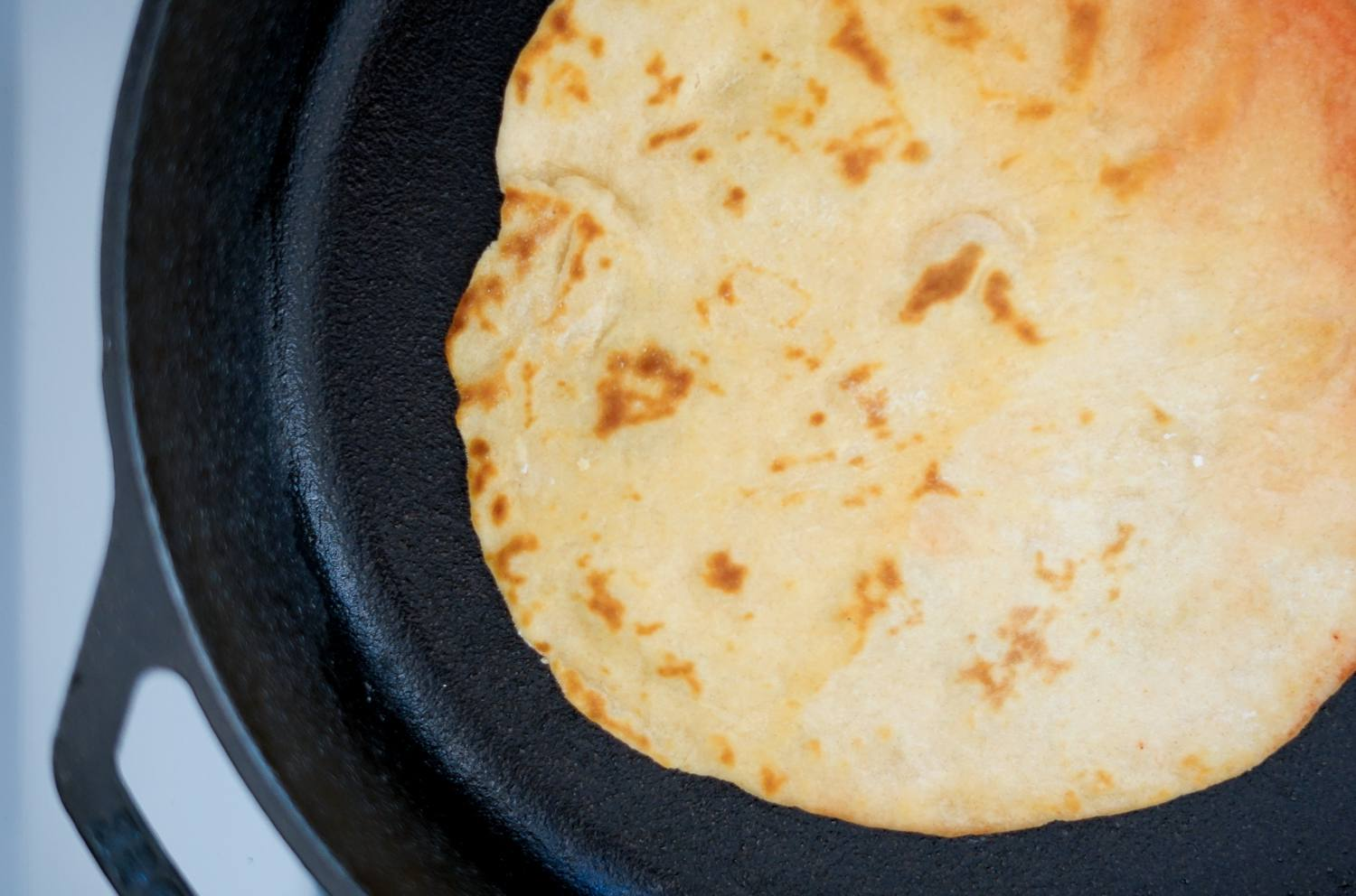 Roti is toasted until golden brown
