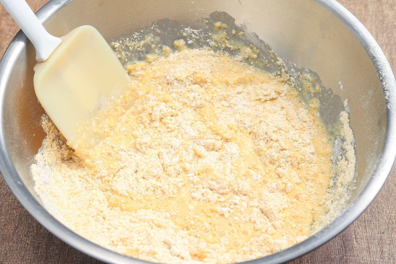Mixing cornbread batter.