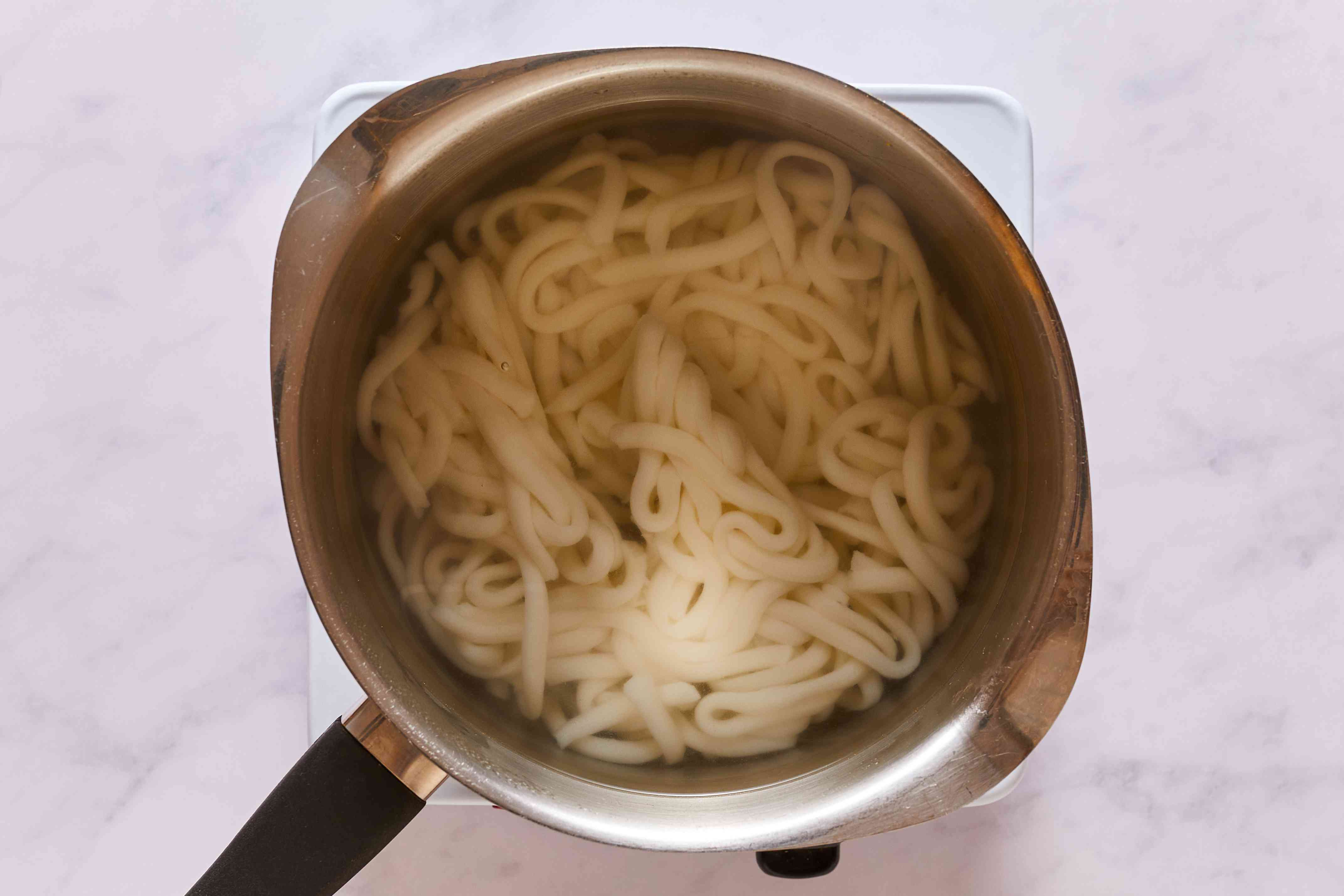 Udon cooking in a pot