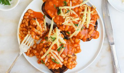 beans on toast on a white plate