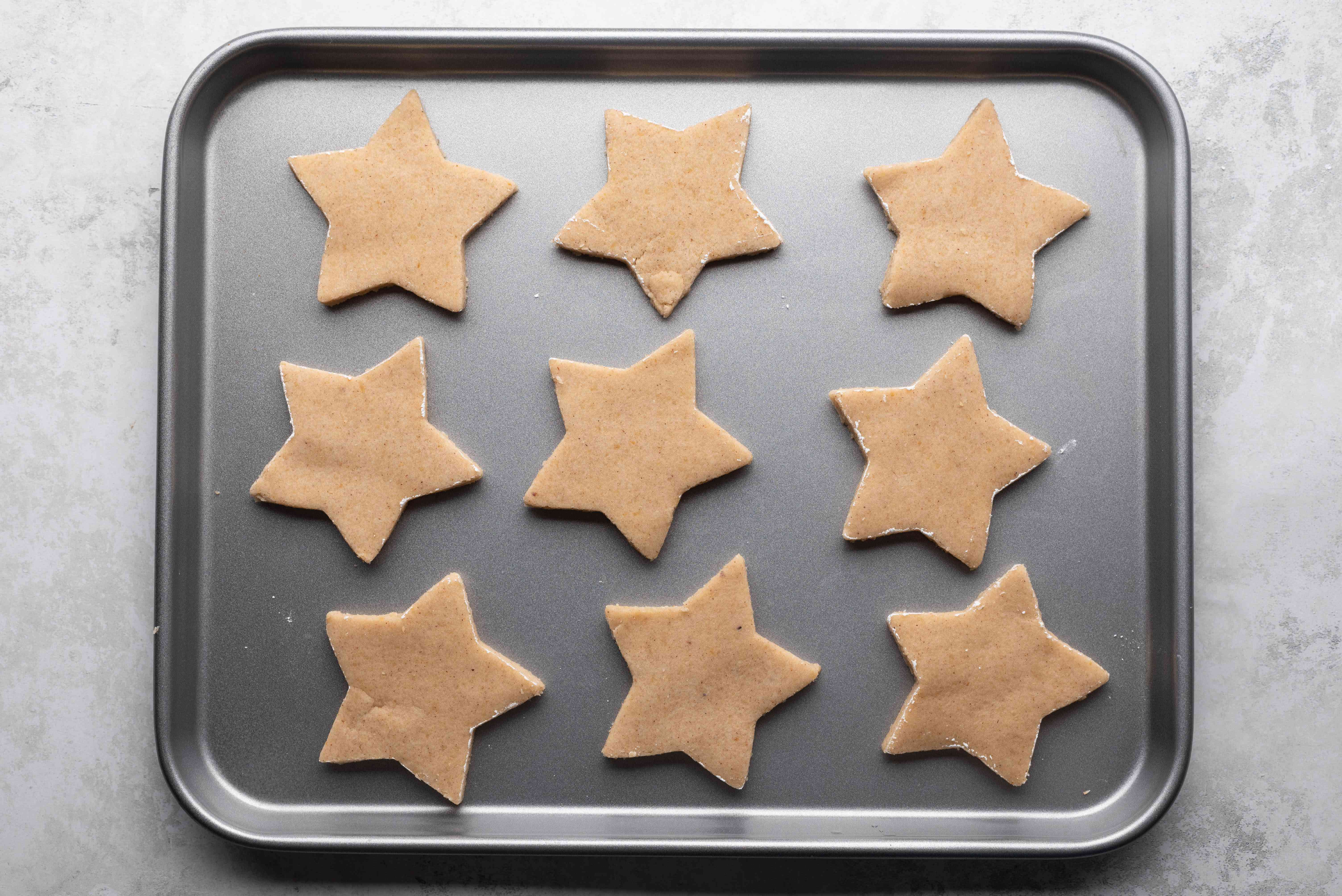 raw star cookies on a baking sheet