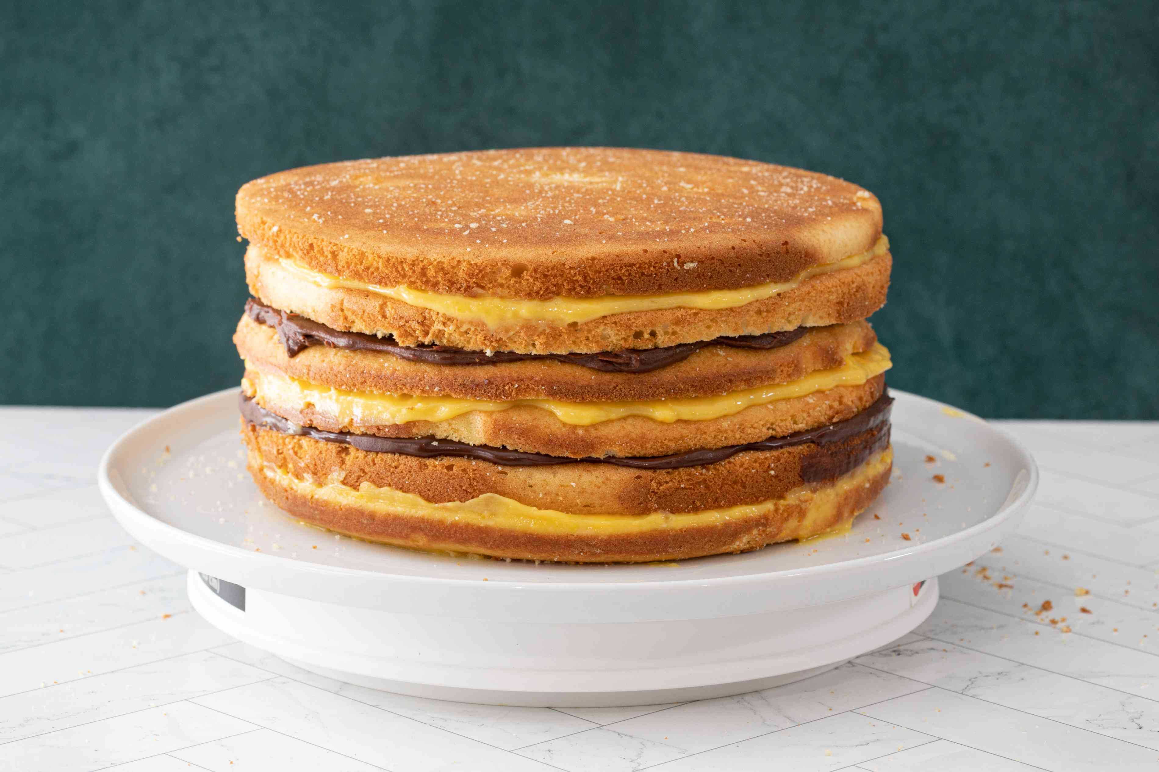 6 cake layers with alternating chocolate and lemon fillings