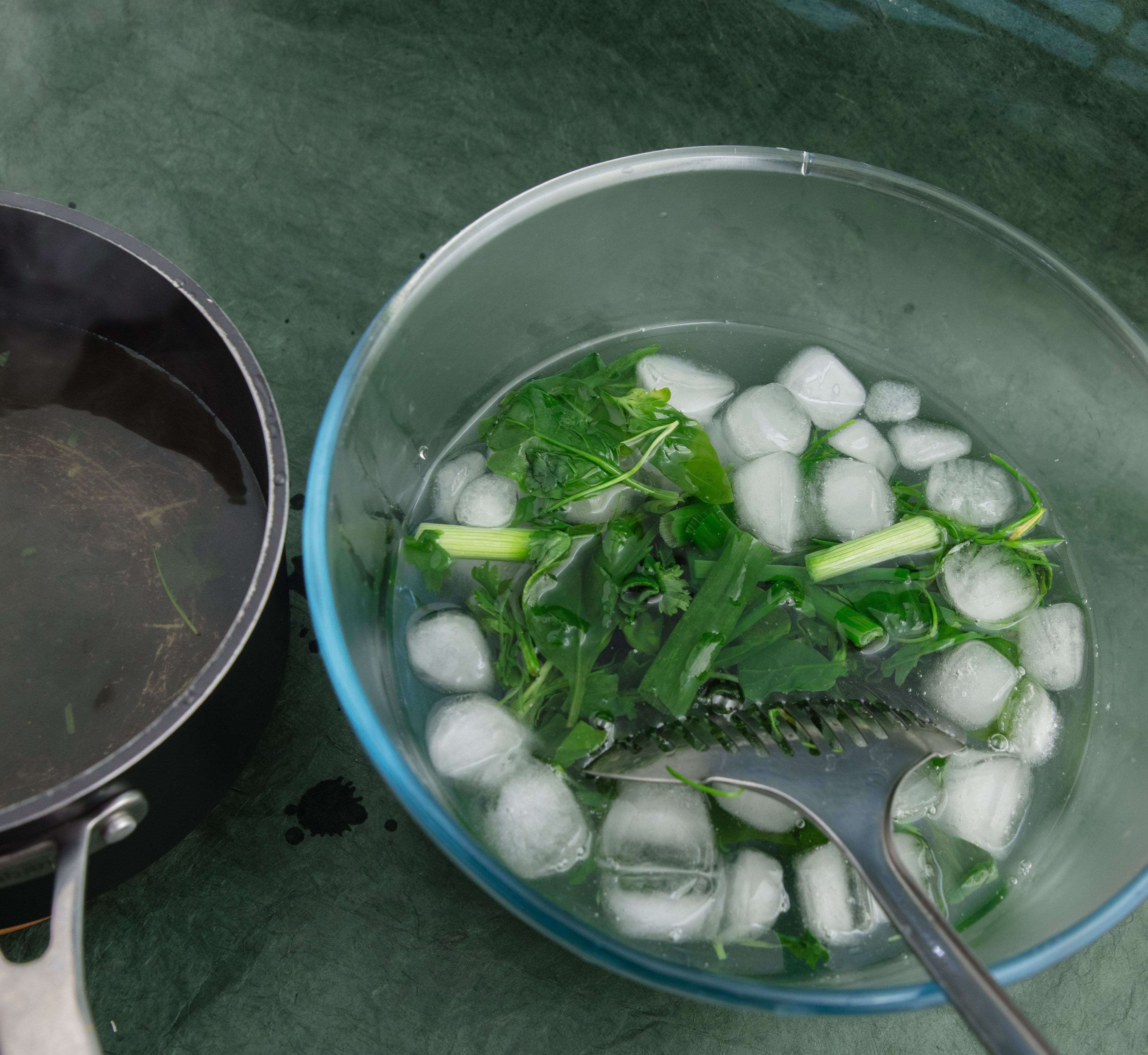 Ice-water bath and blanched green pesto ingredients.