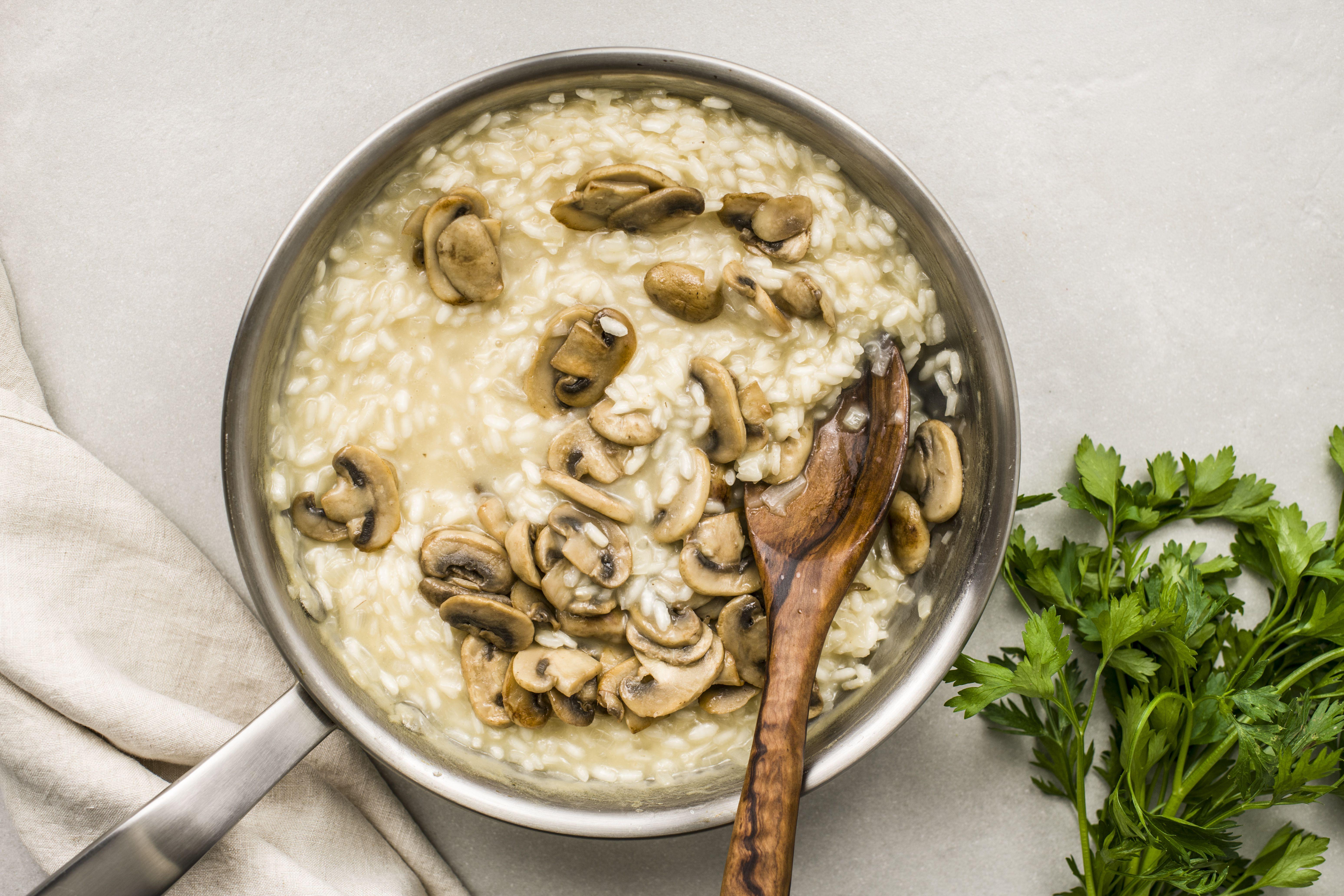 Add mushrooms to pan of rice